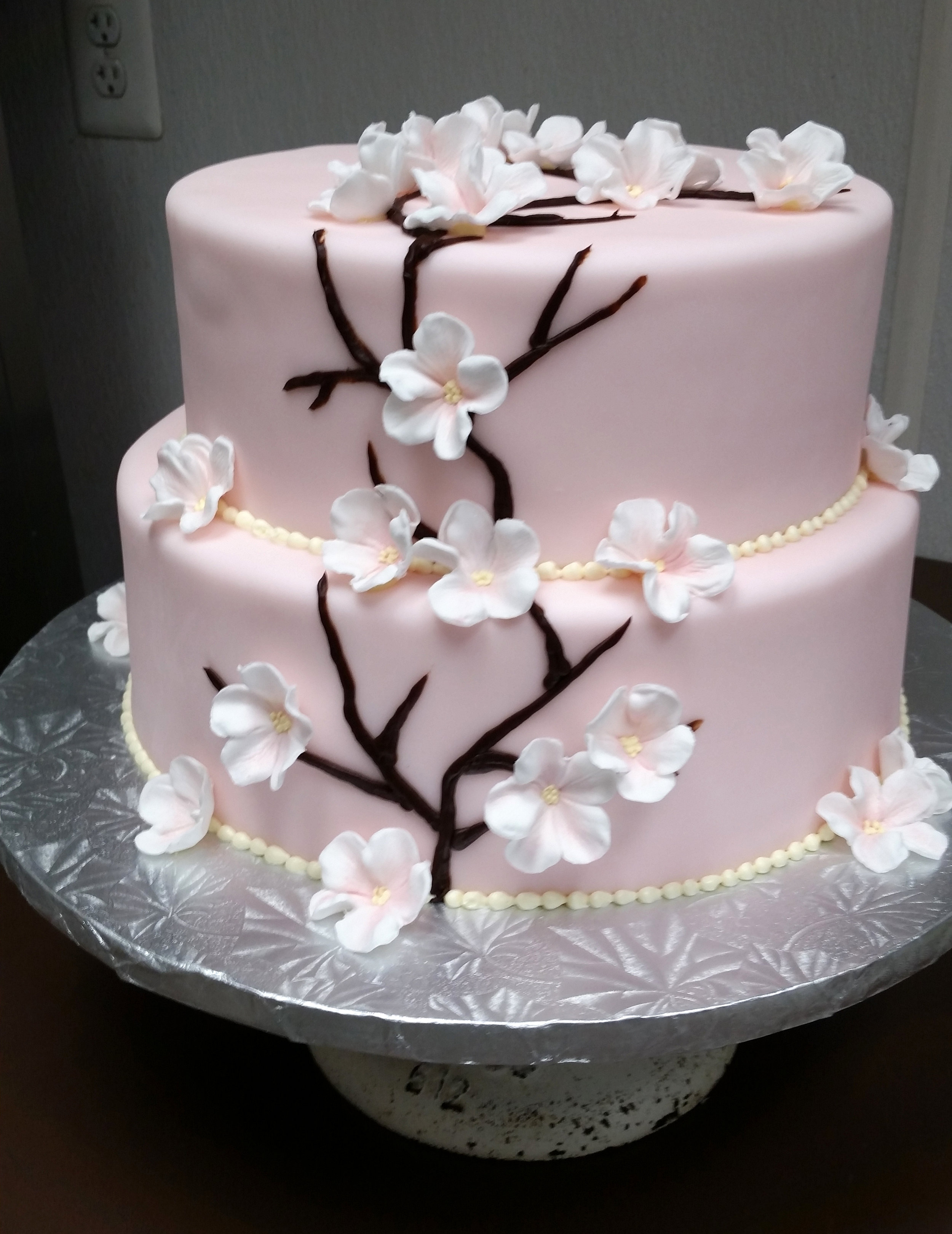 pink flowered engagement cake.jpg
