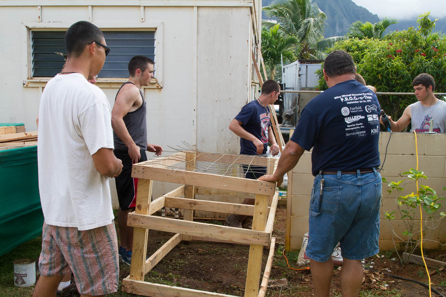 The men are working on constructing a chicken coop for the school.  Eggs are expensive (along with everything else).  This will help reduce the costs for the school.