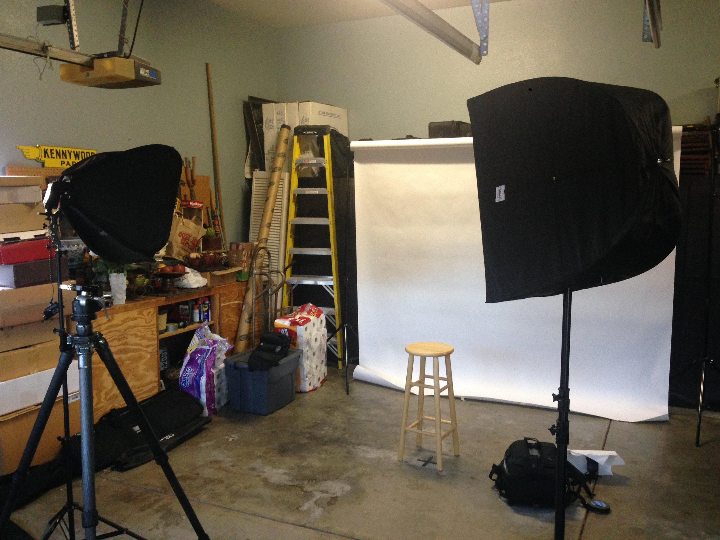 Here's what the setup looked like without anybody standing in for a photo. Keep in mind that in this photo I haven't yet placed the flash behind the stool aimed at the background. You can see it all ready to go off to the right on the floor, but that's not the place where I used it.