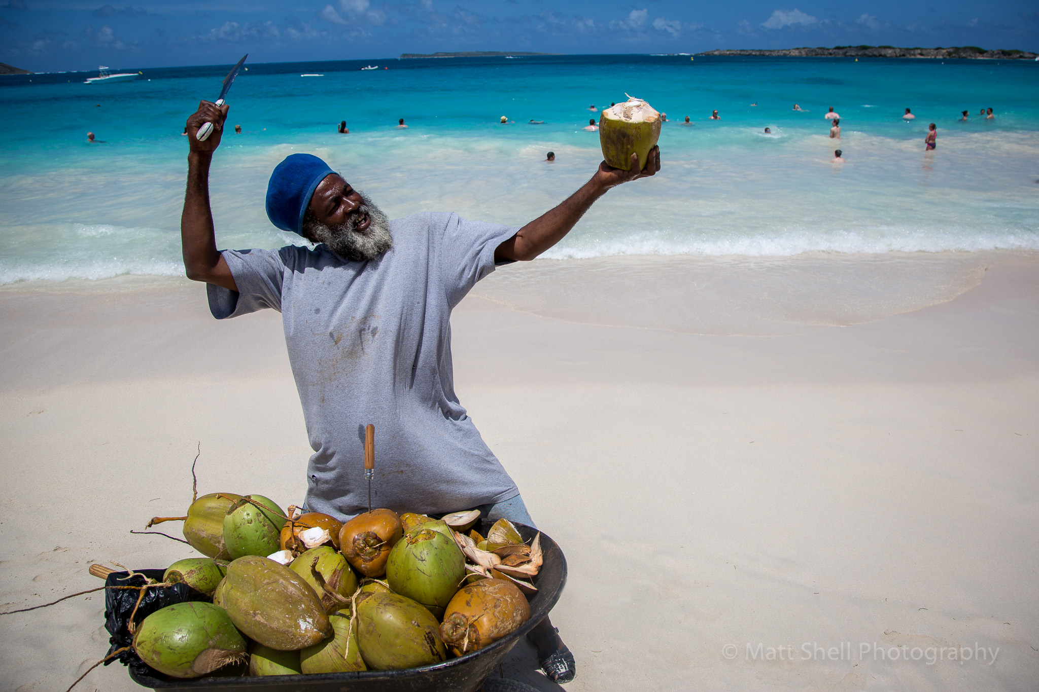This guy was selling coconuts on the beach.  When you see people like this, buy what they're selling and then ask to take their picture.  They'll almost always be happy to let you snap away and may even pose a bit for you like this guy.
