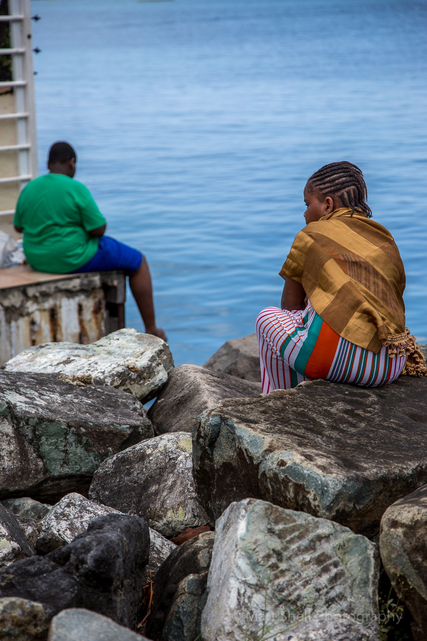 Saw these kids fishing in Marigot. A city on the french side of the island. Love how determined and focused they were and the colors they were wearing looked great.
