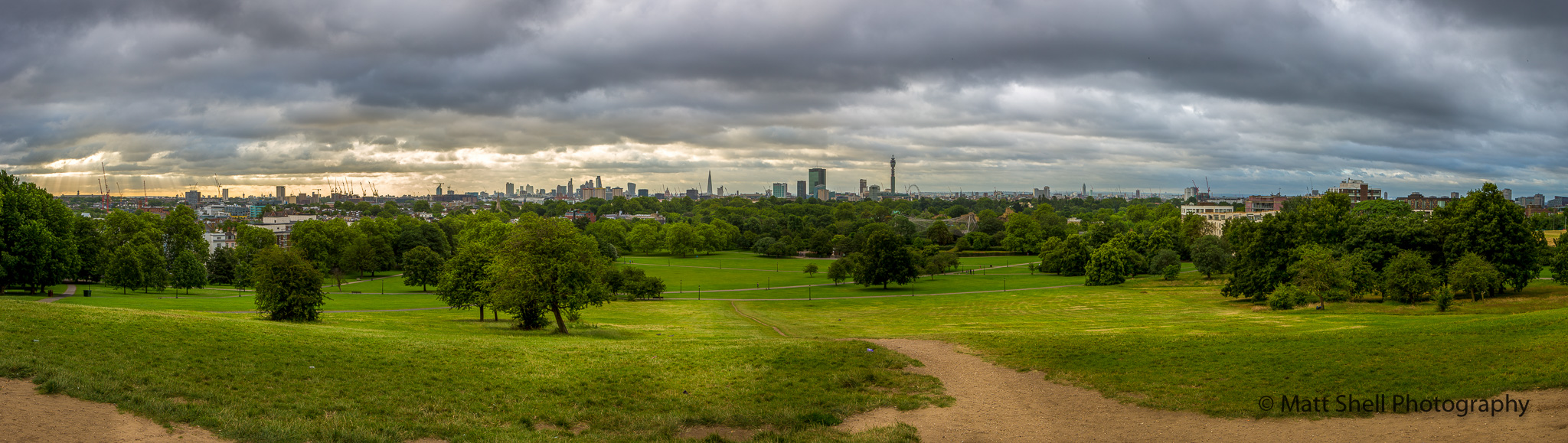 This is the view from standing at the top of the hill, facing central London across the river.  If you look carefully toward the right of center, you can see the London Eye.