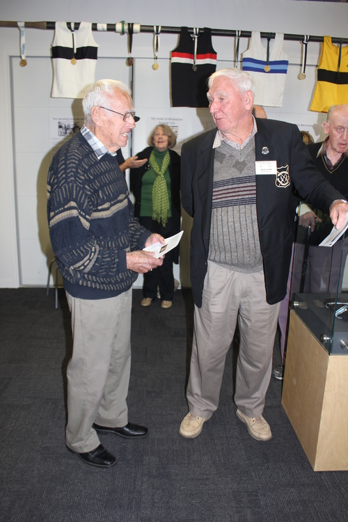Keith Bowering on right talks to fellow life member Geoff Moore  at the museum display at the centenary celebrations.