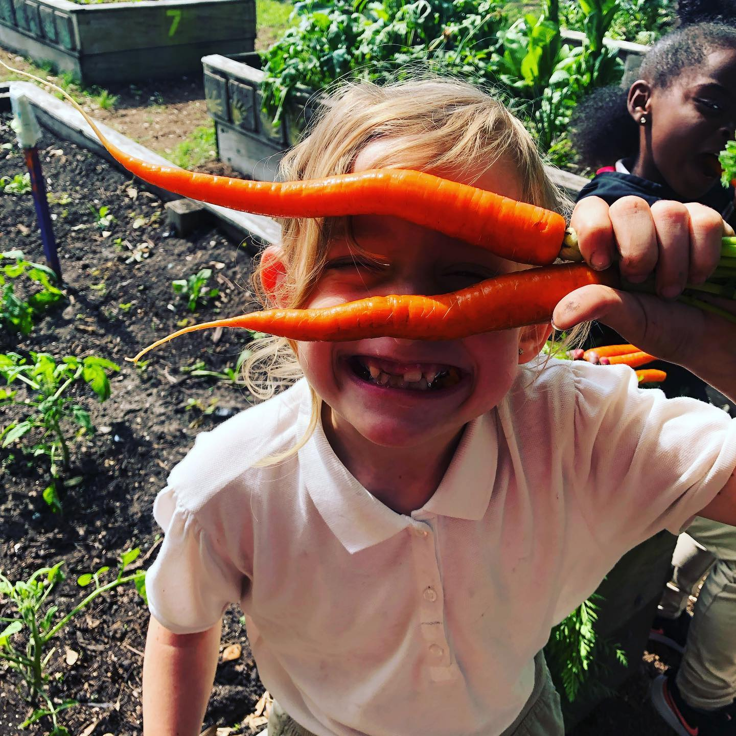 Young Gardeners Program Kid with Carrot