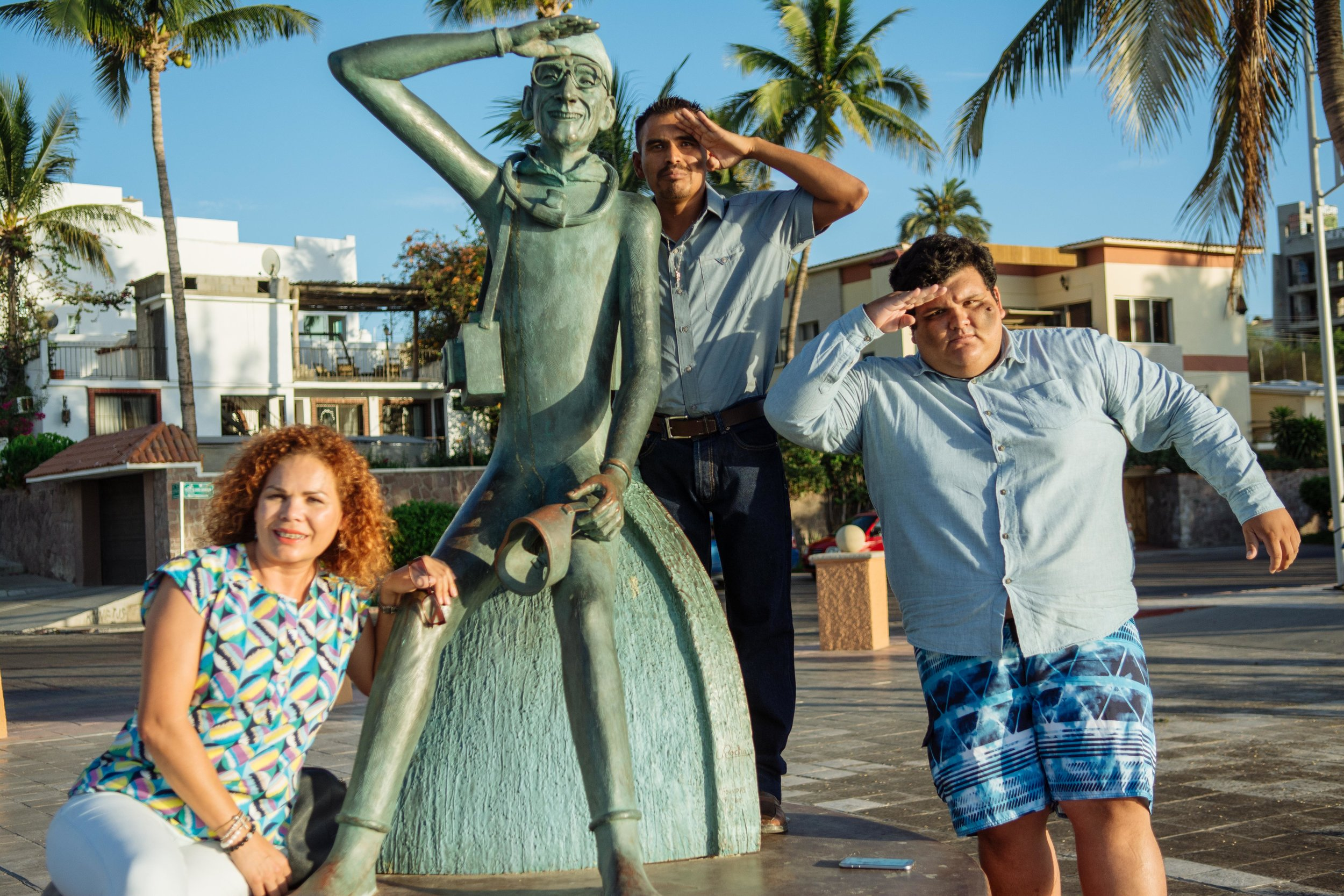 "Claudia, Rey, and Roberto pose with a statue of Jacques Cousteau in La Paz. Cousteau described the Sea of Cortez as ""the world's aquarium."""