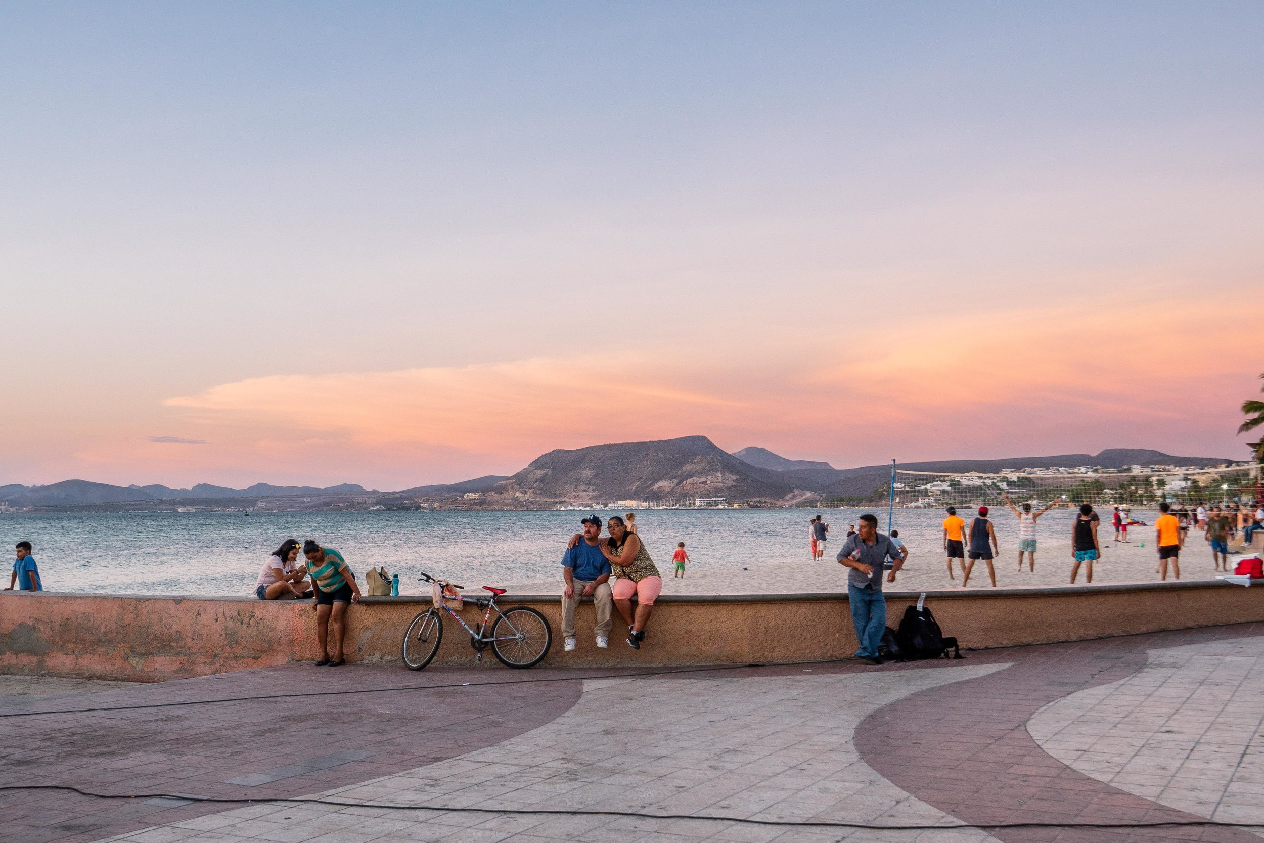 The street along the ocean in La Paz, El Malecon, bustles at sunset when the air is cool enough for people to come outside.