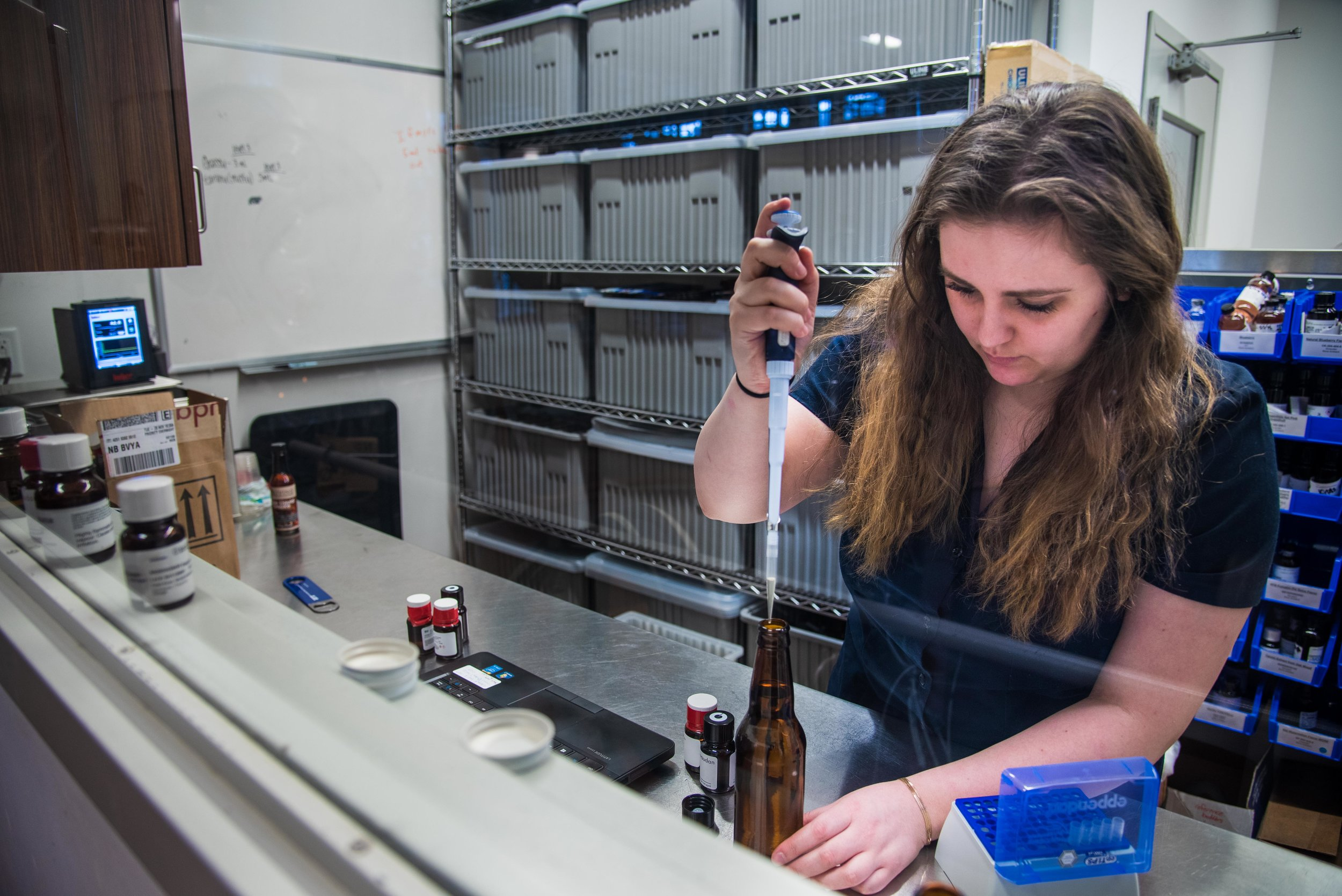 Rebeca Conway, Psychology '20, tests flavors in various beers as part of her co-op in the sensory lab.