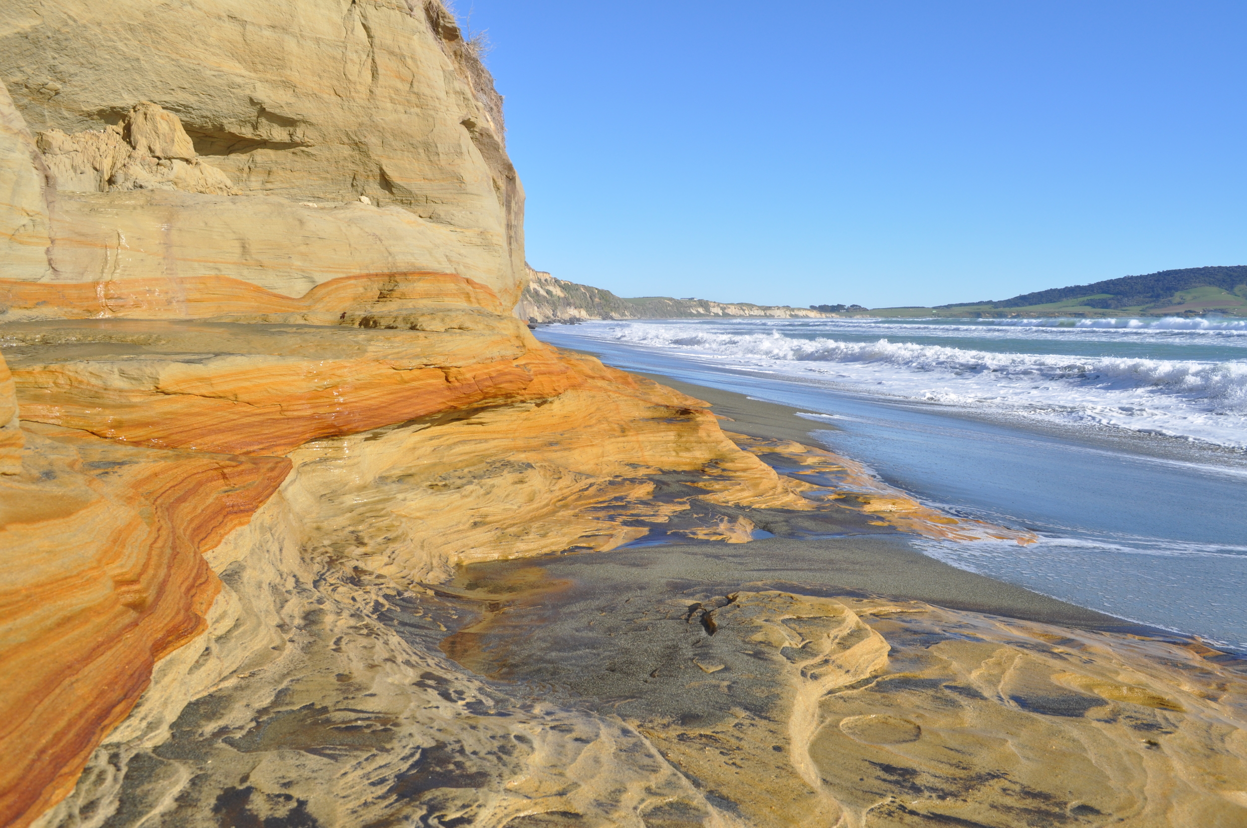 Sandstone cliffs lined the water and exposed layers of history