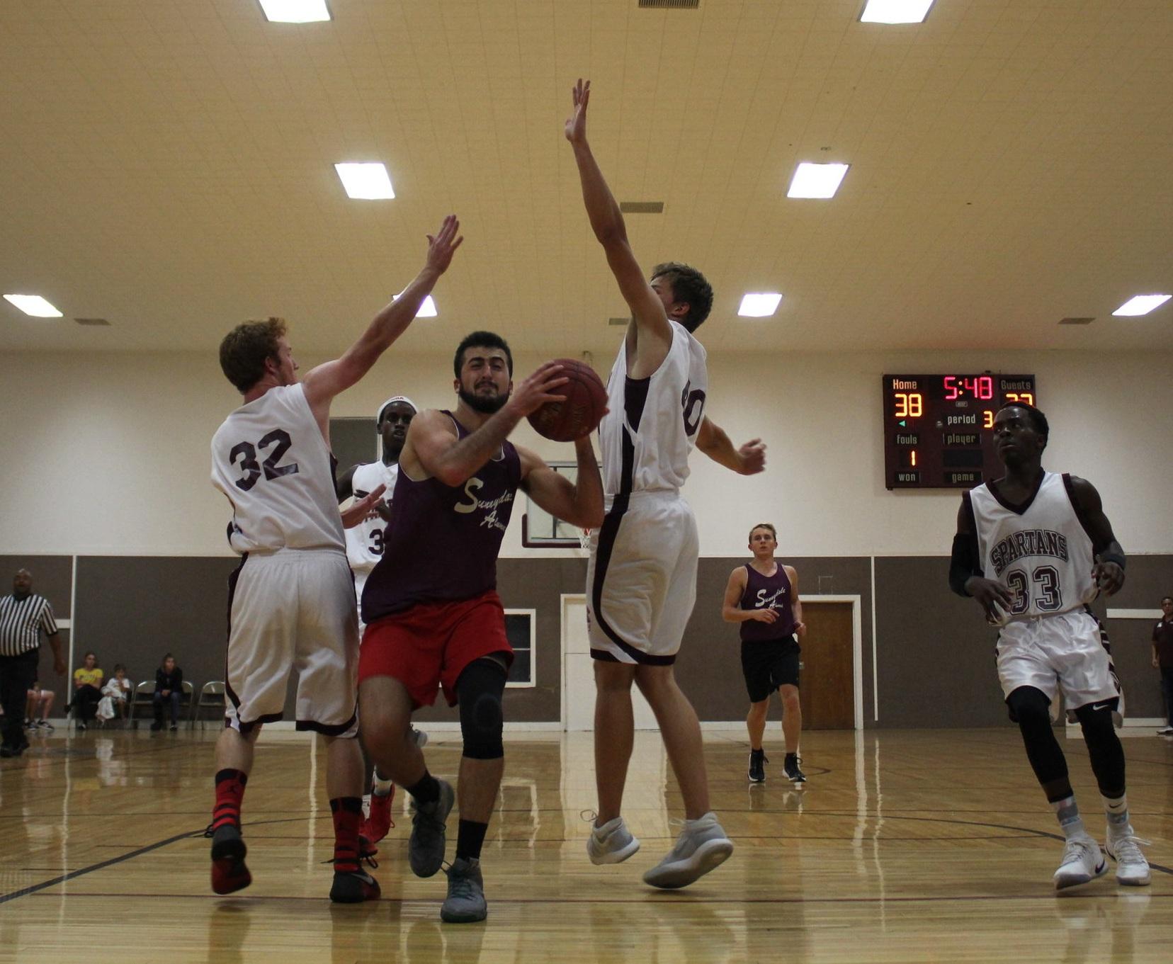 Logan ('17) splits the defense