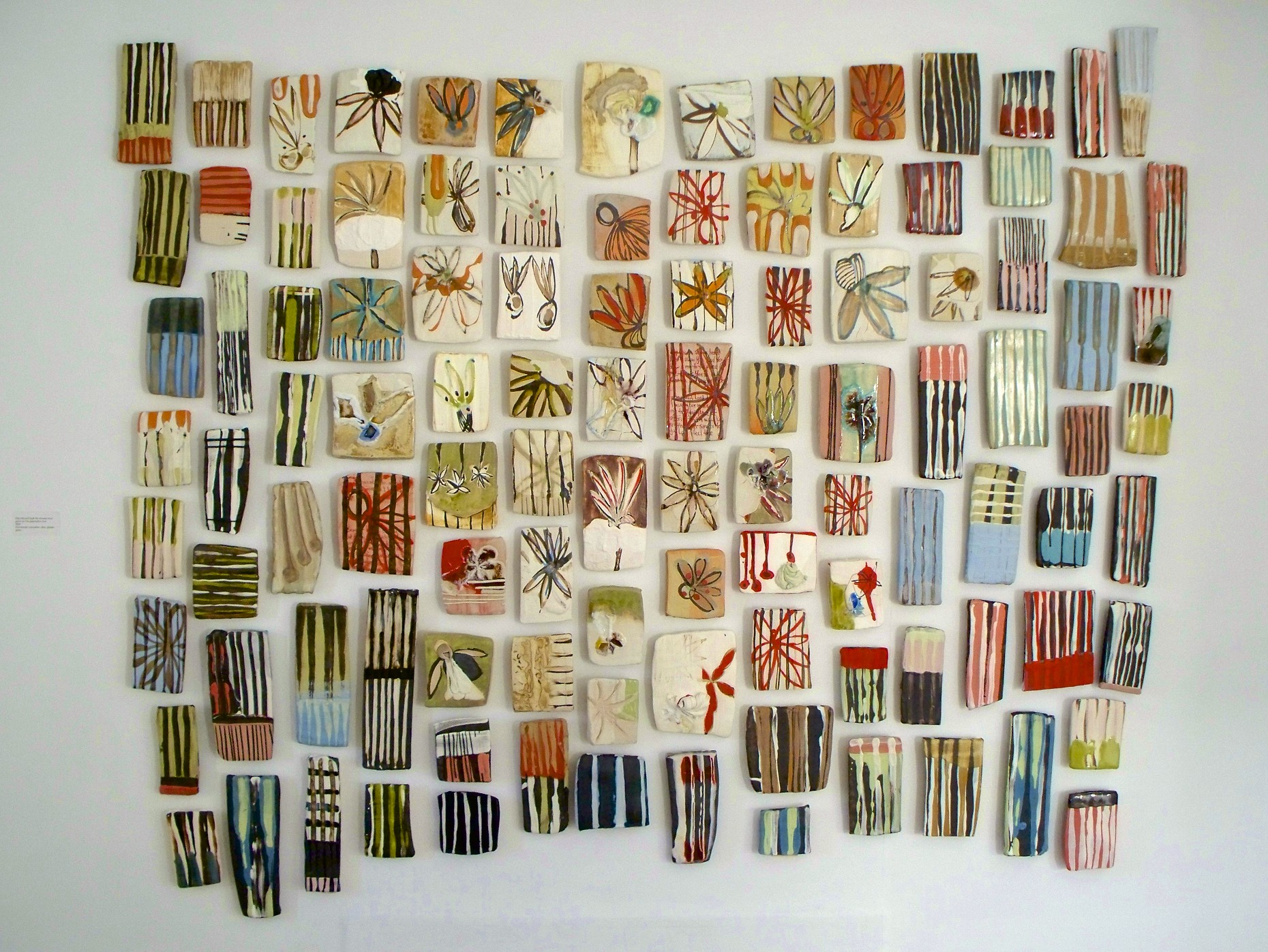 Strip Pieced Quilt #5: 'flowers that grew on the plantation', stoneware, porcelain, colored slips, glass, glaze, 6' x 7' (dimensions variable), cone 6 oxidation, 2009