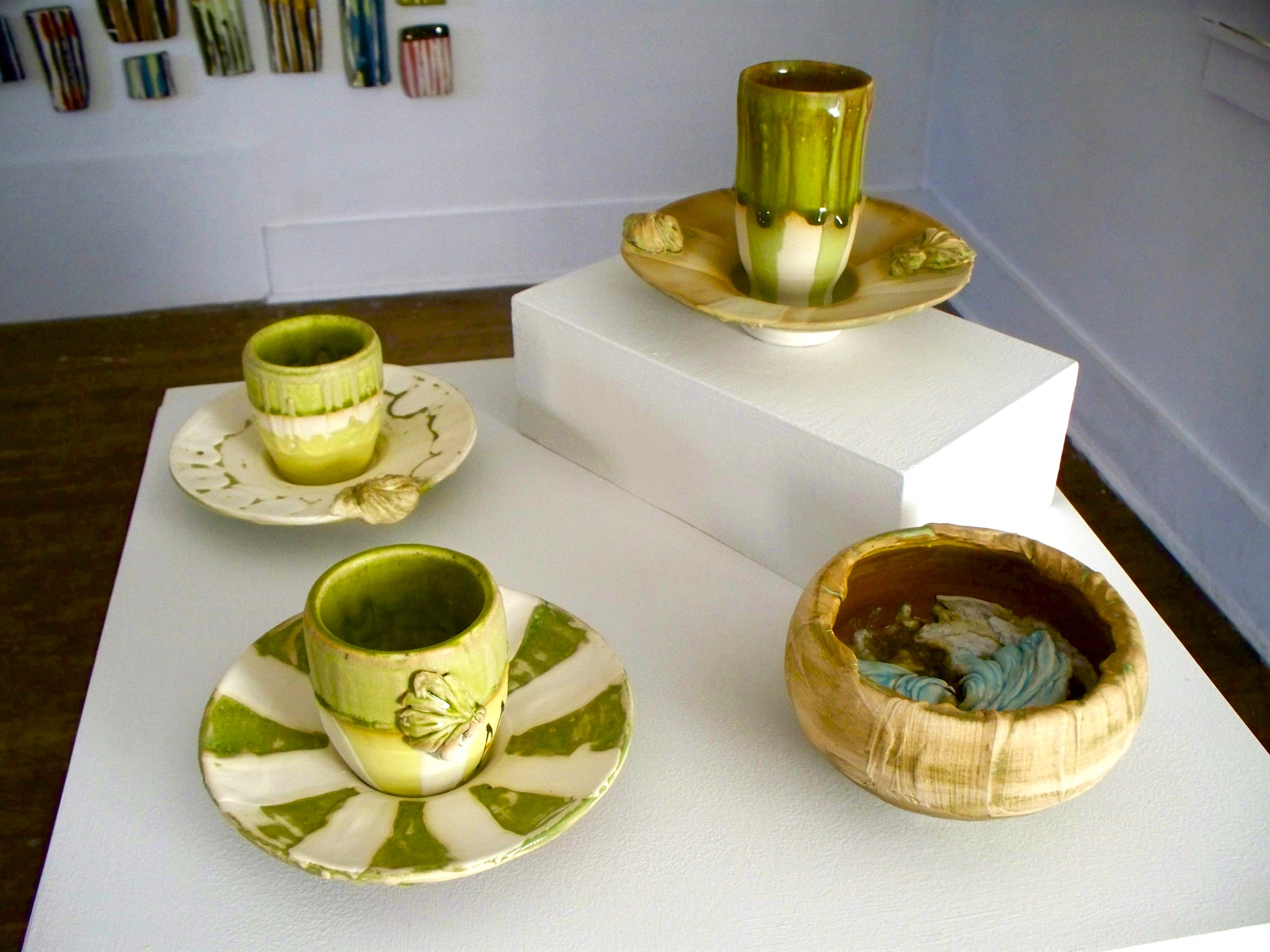 'afternoon break',  tea cups/saucers and 'sugar bowl', porcelain, stoneware, colored slips, glaze, glass, silica sand, dimensions variable, 2009
