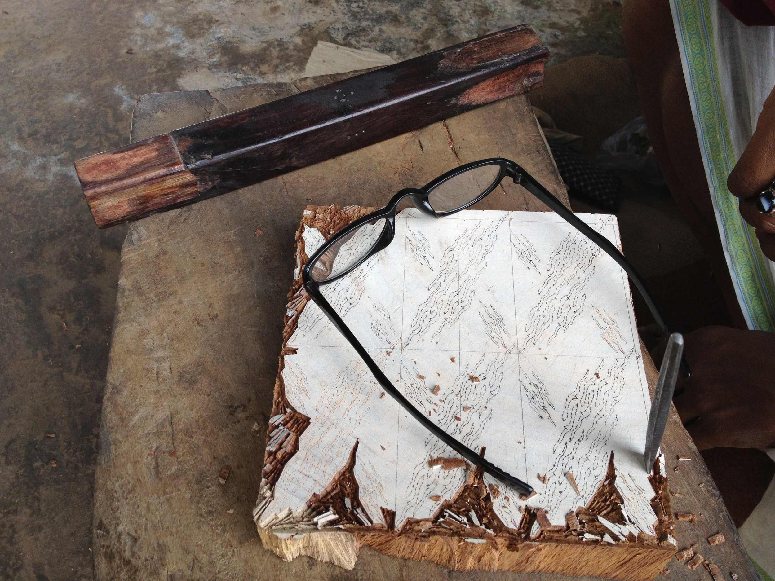 Jogdish's work station, eyeglasses, wooden block, tools, Khojwa, Varanasi, 2013