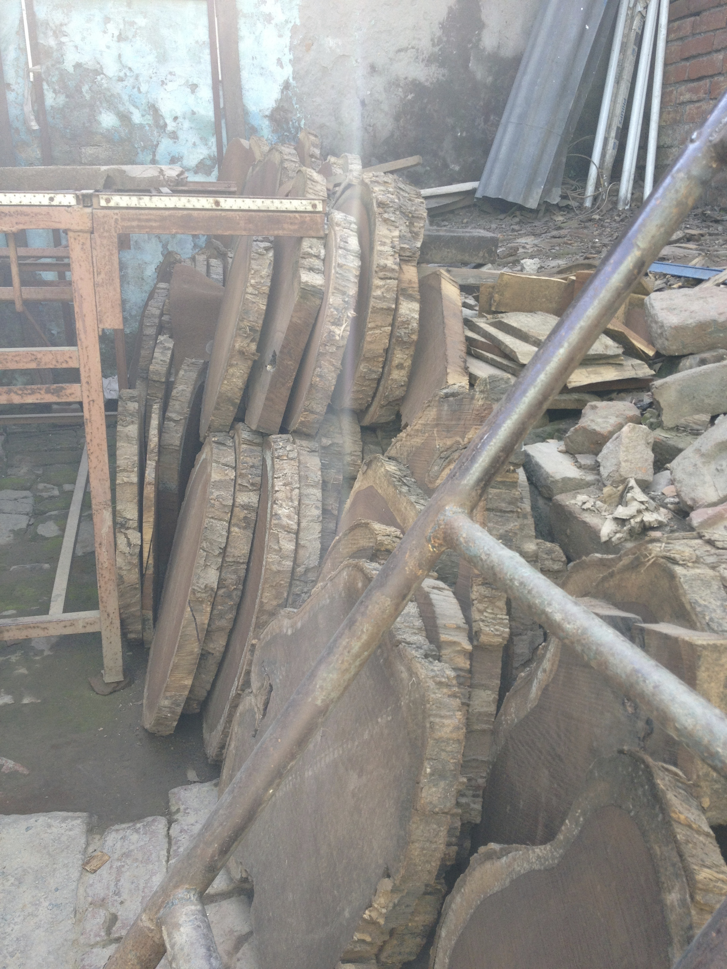 tree slabs of wood for block carving in Subbash's shop