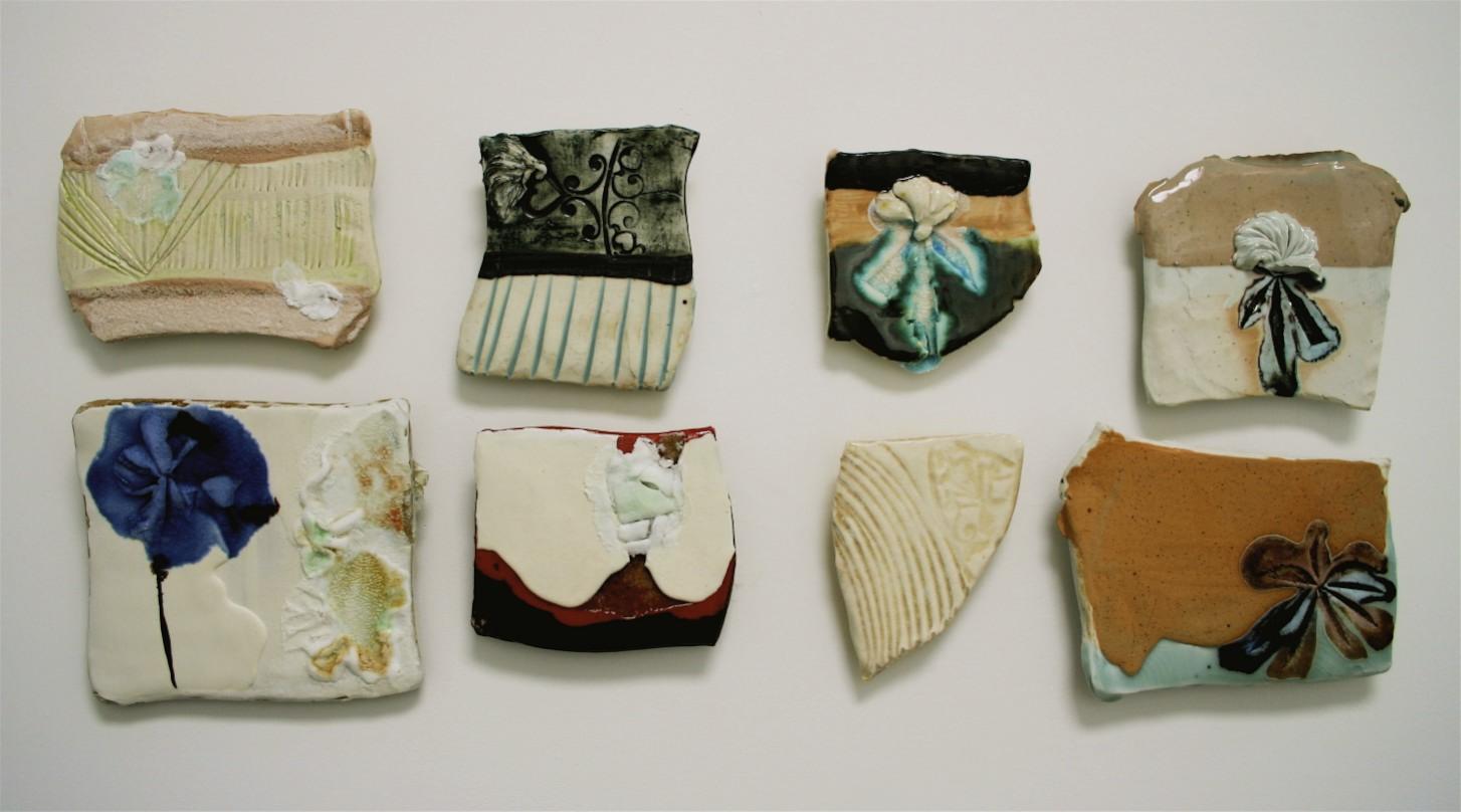 "Patchwork: appliqué, porcelain, glaze, glass, silica sand, colored slips,  38"" x 15"" (dimensions variable) 2007"