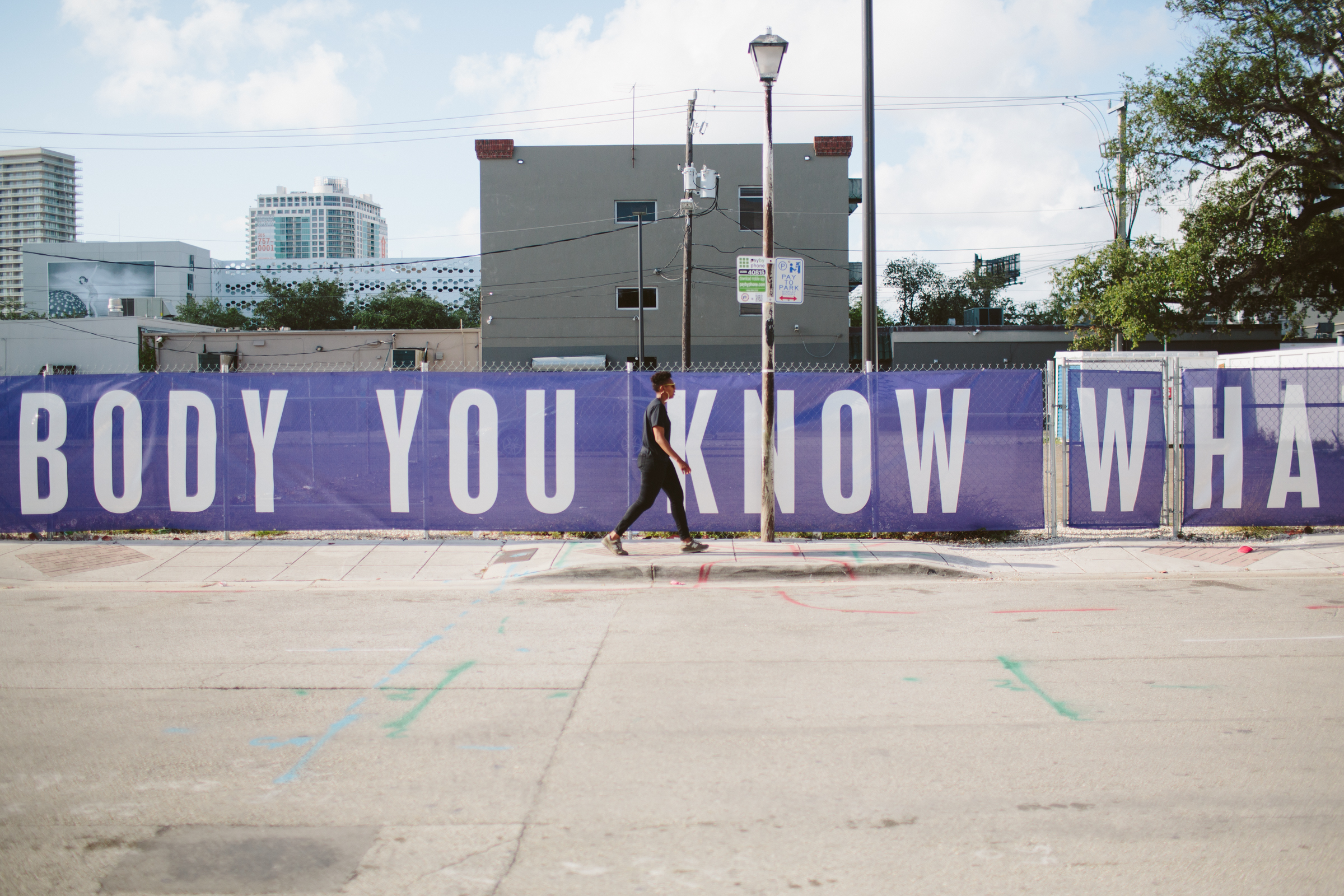 NE 1st Avenue & 41st Street in the  Design District , where Martine Syms has installed a purple-and-white banner with the words Sam Cooke spoke to his audience at Harlem Square on one side, and the words of his audience spoke back on the other.