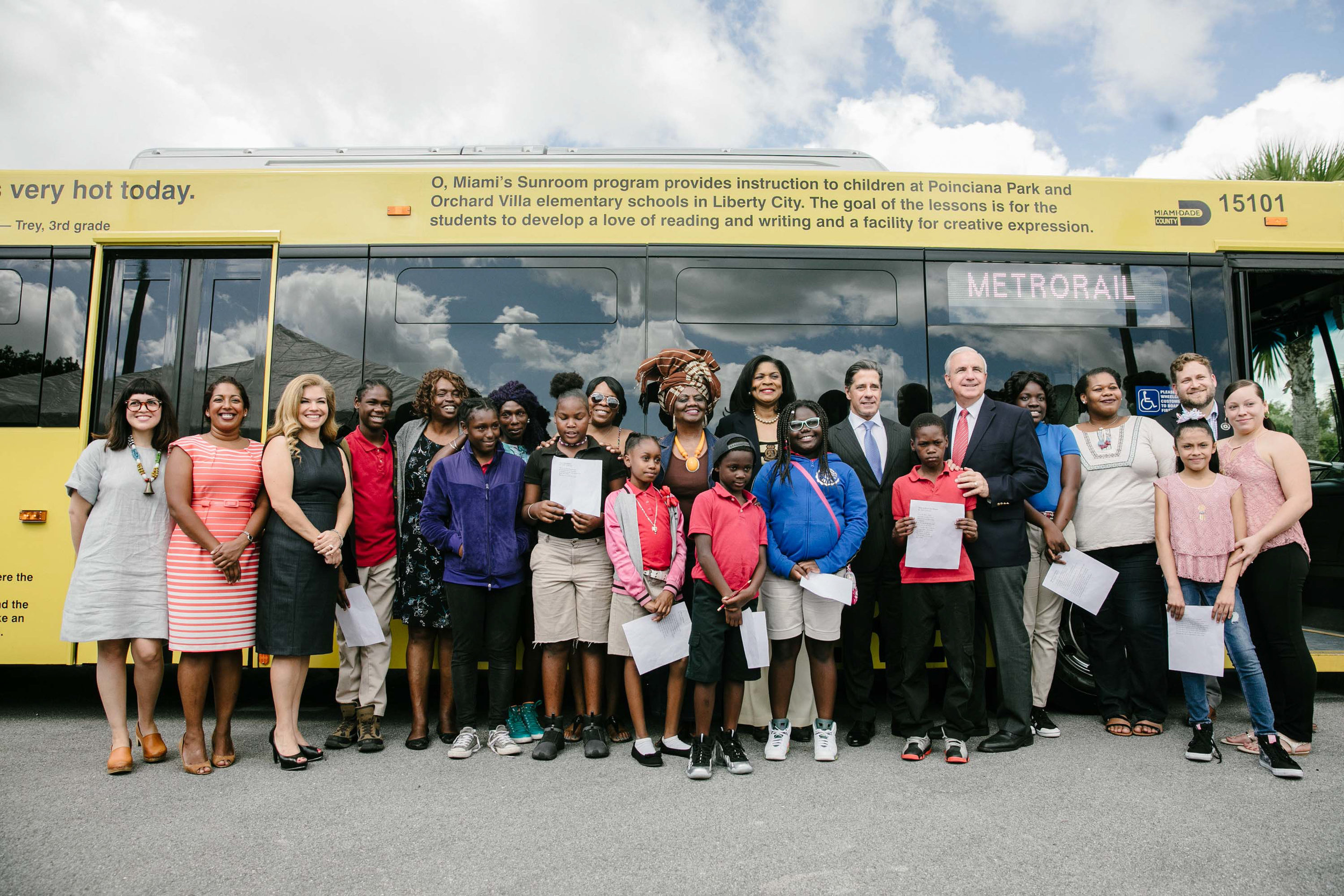 The student poets and family members, joined by Mayor Carlos Gimenez, Superintendent Alberto Carvalho, Dr. Dorothy Bendross-Mindingall, Transit Director Alice Bravo, and Dr. Amrita Prakash.