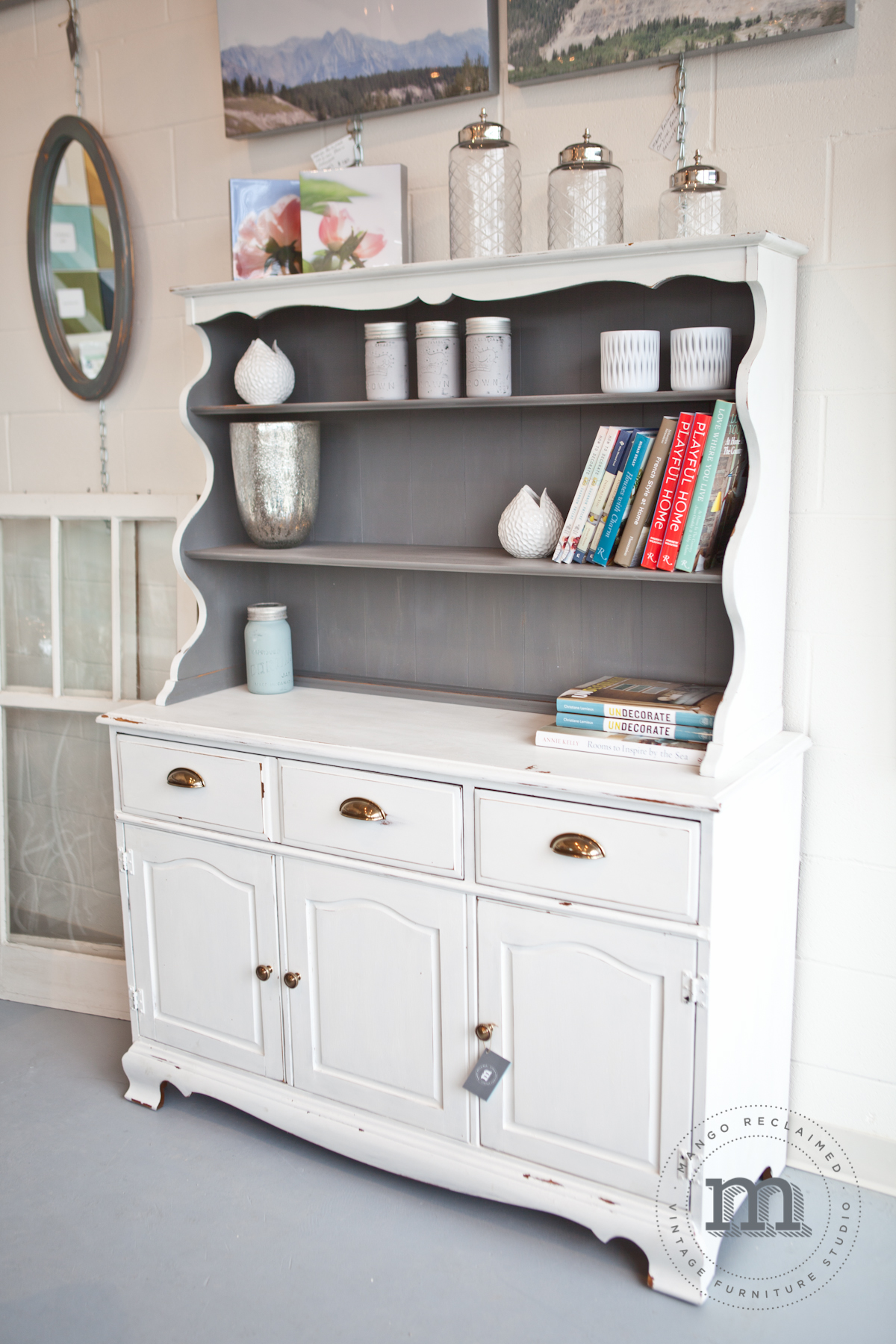 Painted in Miss Mustard Seed's Milk Paint 'Ironstone' and 'Trophy'. This hutch is currently available for $895.