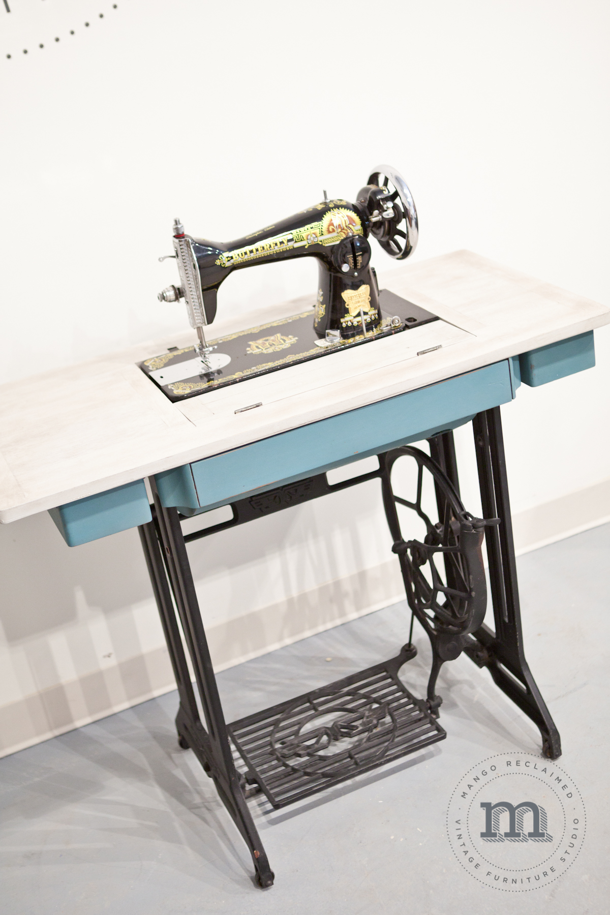 The sewing machine sitting on the table is a great conversation piece and can be tucked away discreetly when the table top is needed for entertaining. A beautiful piece that is truly multi-functional AND holds great sentimental value.