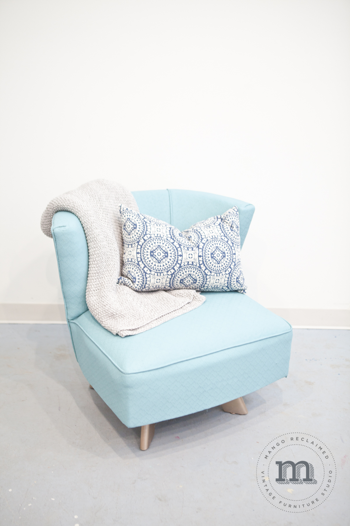 Painted upholstered swivel chair available at Mango Reclaimed, $275.