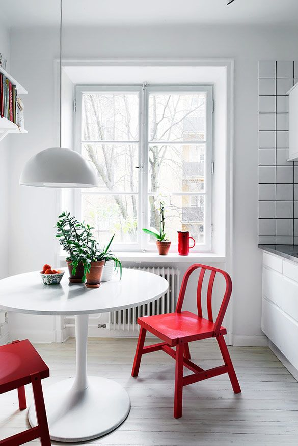 I love the pop of colour from these red chairs in a bright white space. See more  here .