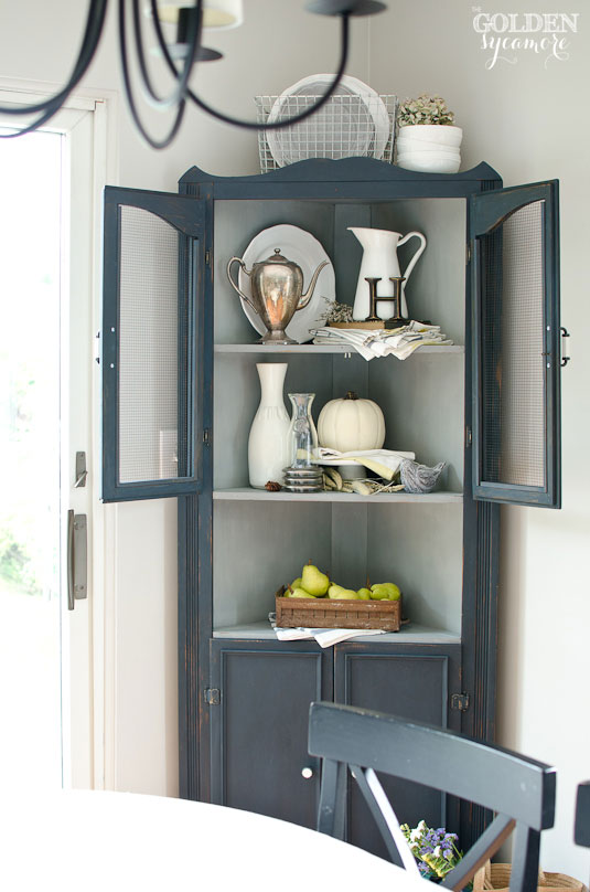 artissimo-navy-blue-painted-corner-cabinet.jpg