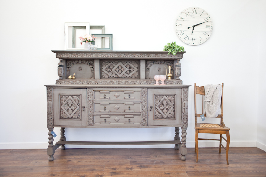 Antique ornate dining buffet restyled in Zeppelin grey with medium distressing and antique wax finish.