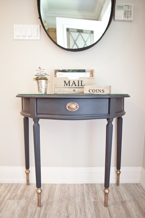 Entrance table restyled in Mascara and mild distressed with gold painted details.