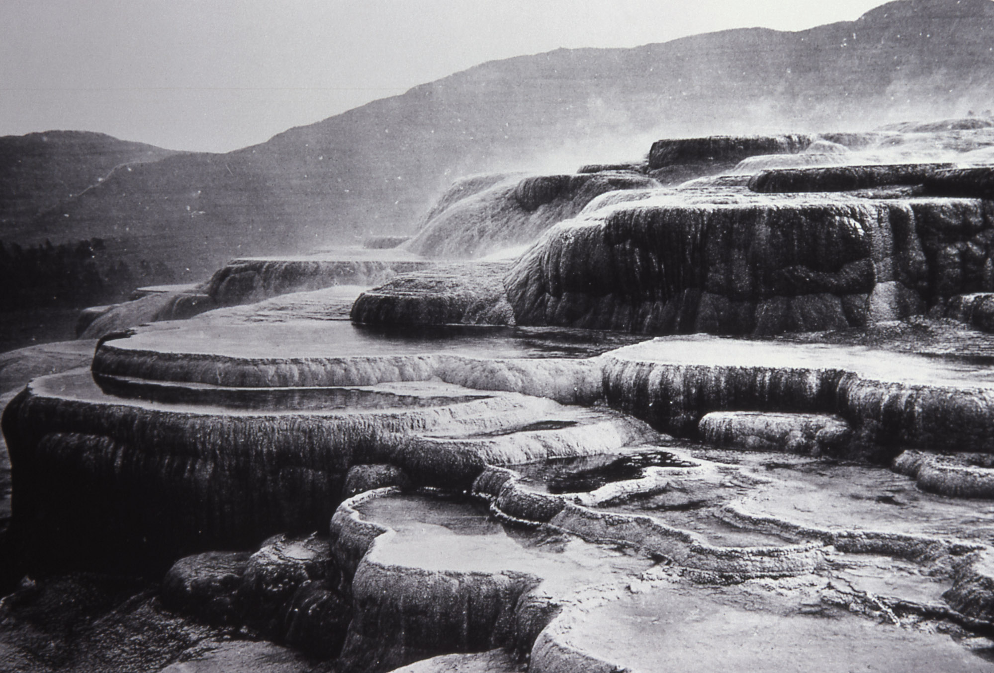 A photograph of the Summit of Jupiter Terraces taken by William H. Jackson. Paintings and photographs of Yellowstone were crucial to its establishment as a national park.
