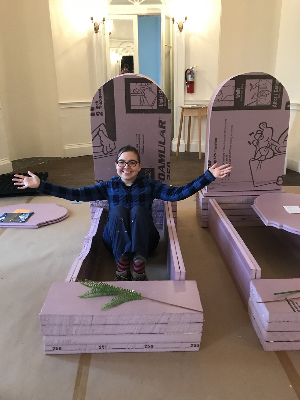 BEFORE: Grave Gardener Emma Hollier shows us what life size pink foam headstones look like.