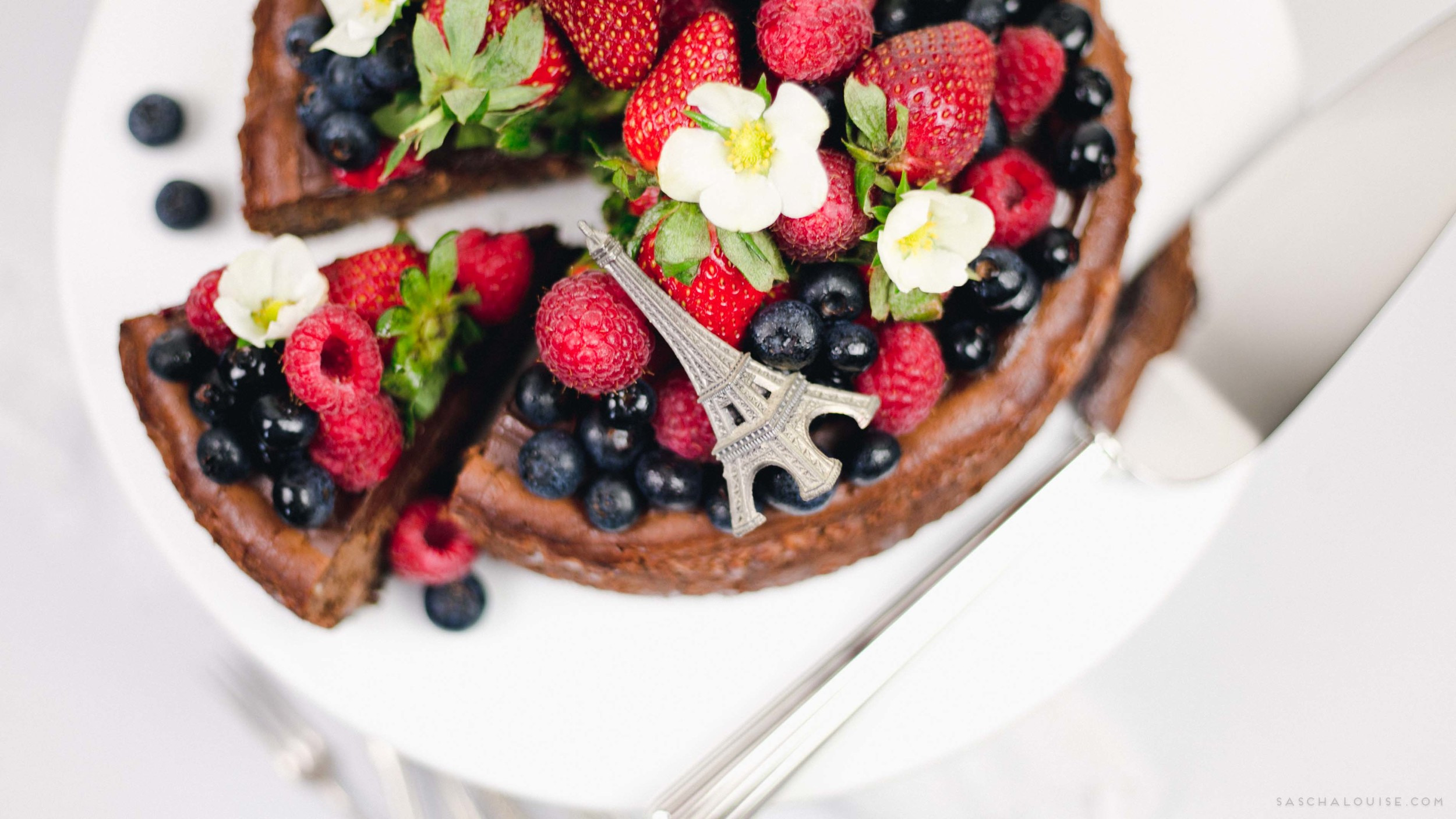 Baked Chocolate Cheesecake topped with fresh berries