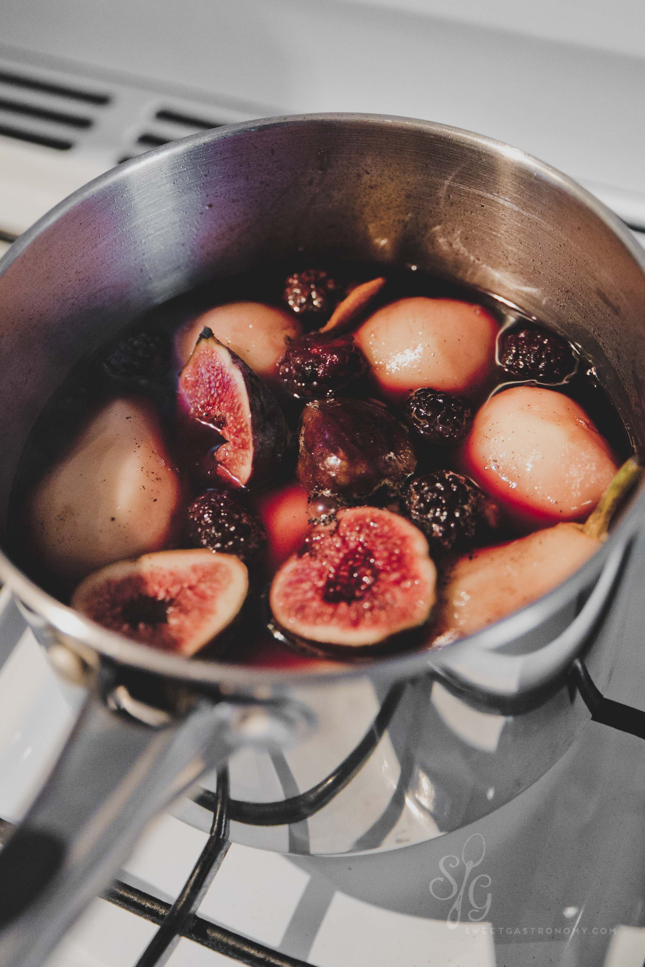 Poaching fig, pears and blackberries.