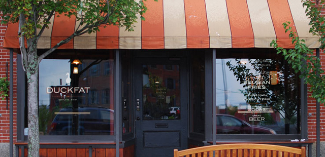 We worked with cream and orange tones to tie new materials into the restaurant's existing striped awning.