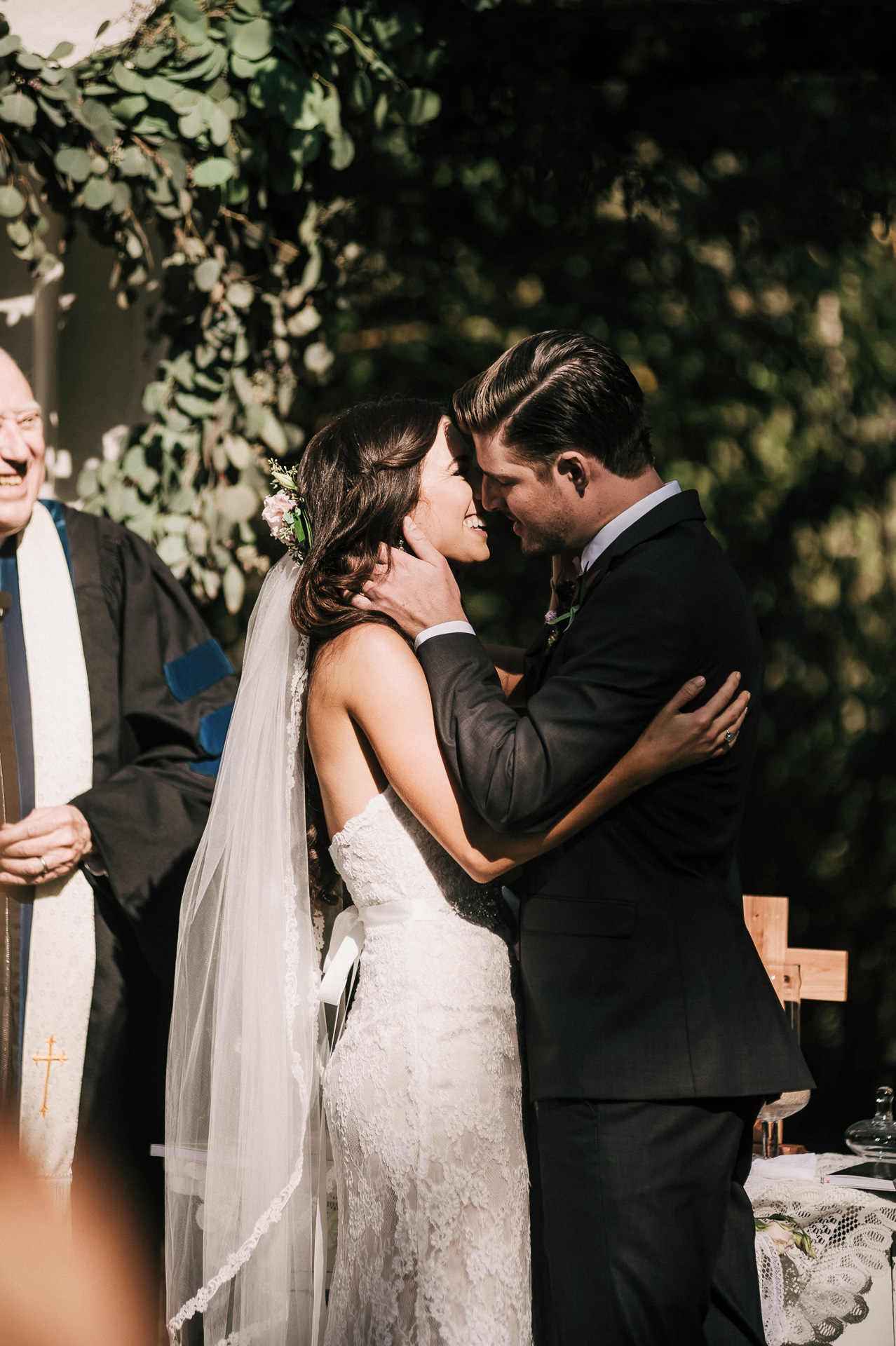 Wedding photographer captures first kiss during a lovely wedding at Quail Haven Farm.