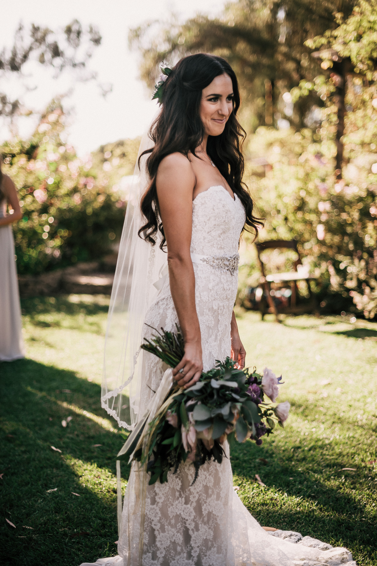 The sun sets on this beautiful bride at the rustic Quail Haven Farm in Vista, California.