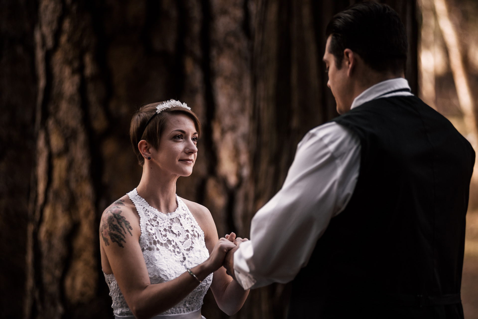 Sweet couple says their vows during yosemite elopement at swinging bridge