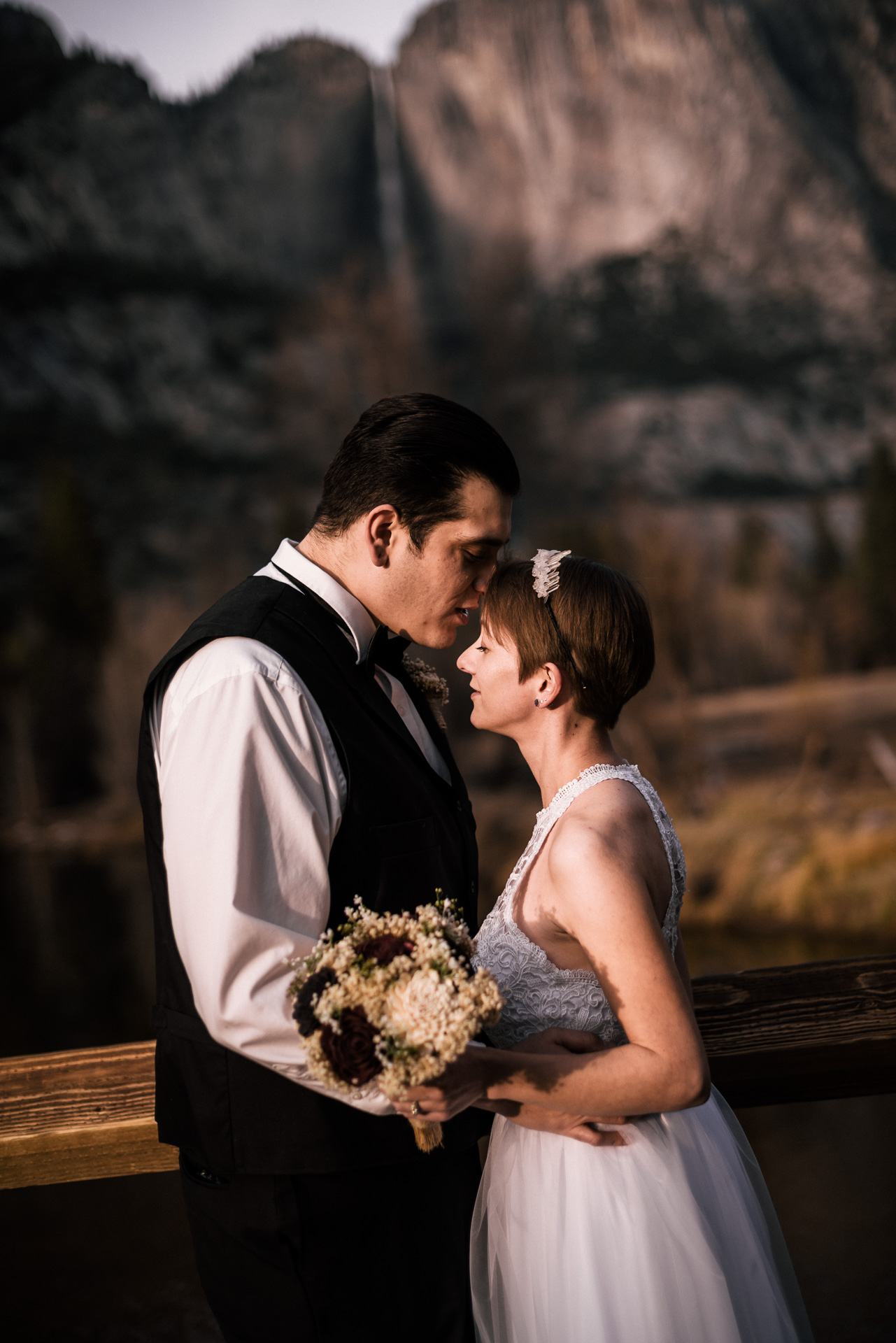 couple elopes to yosemite for romantic wedding photos at swinging bridge
