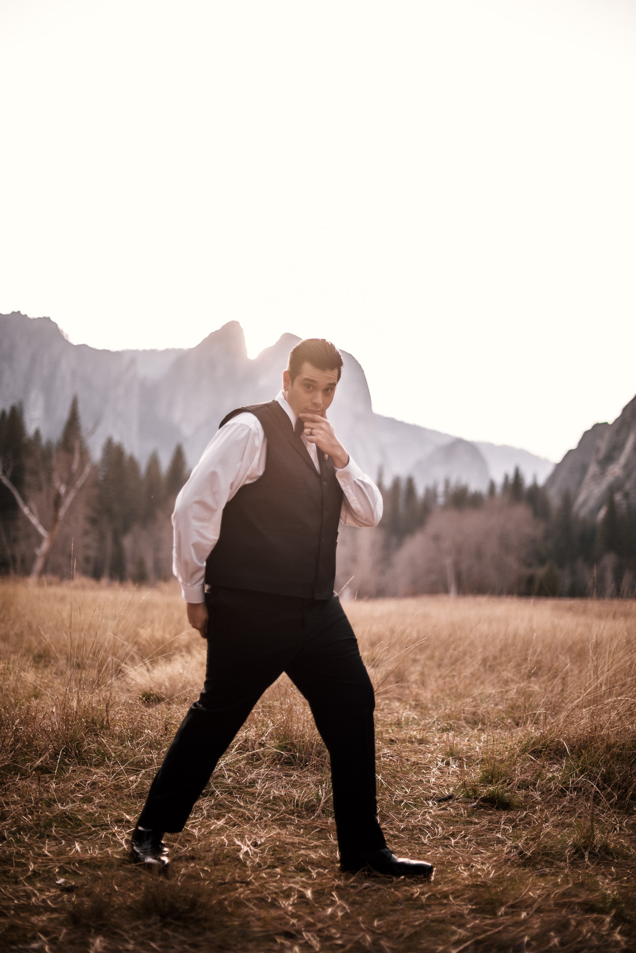 Yosemite elopement photographer captures groom goofing around in meadow