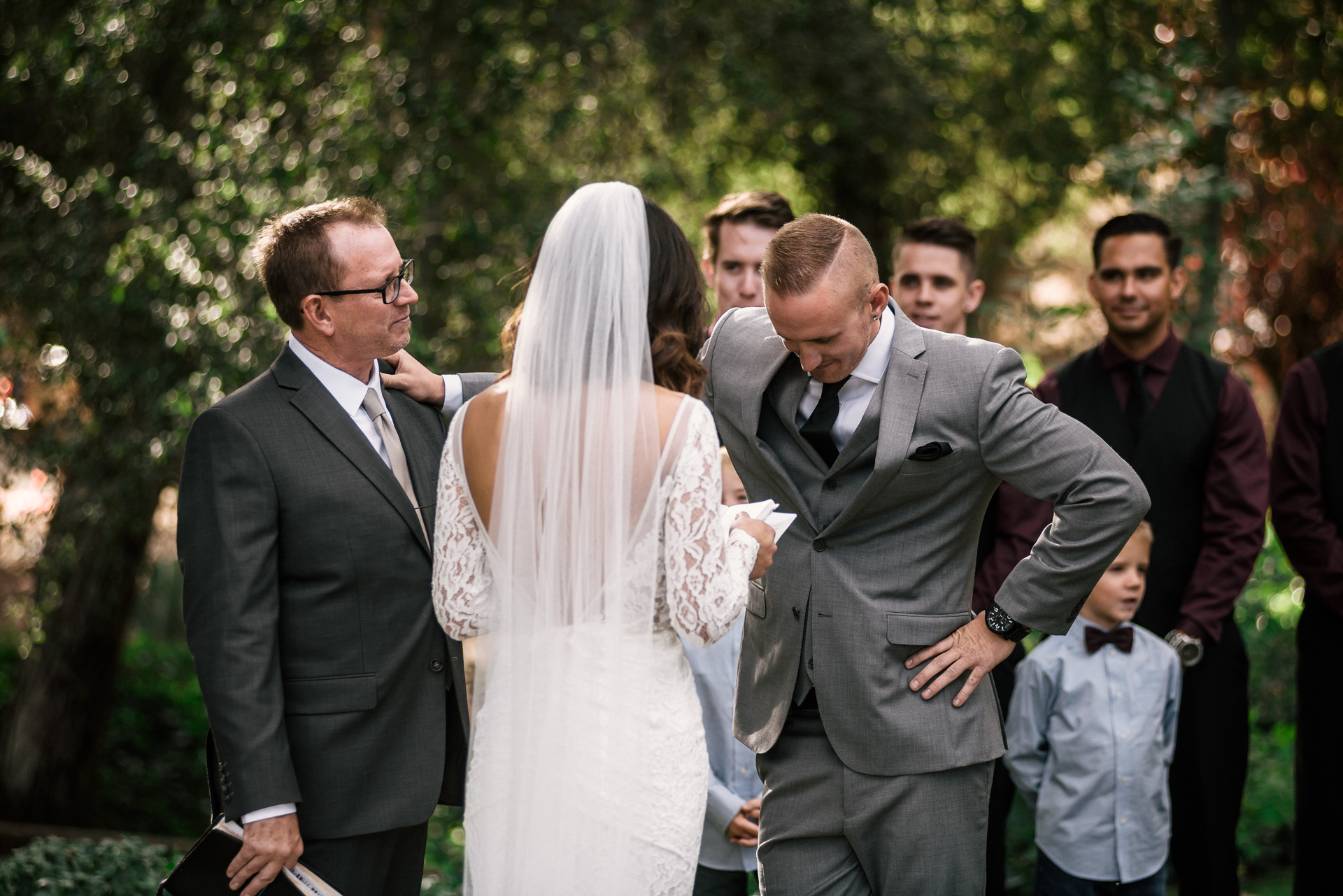 groom overcome with emotion holds on to father at rustic pymm ranch wedding venue in winchester california