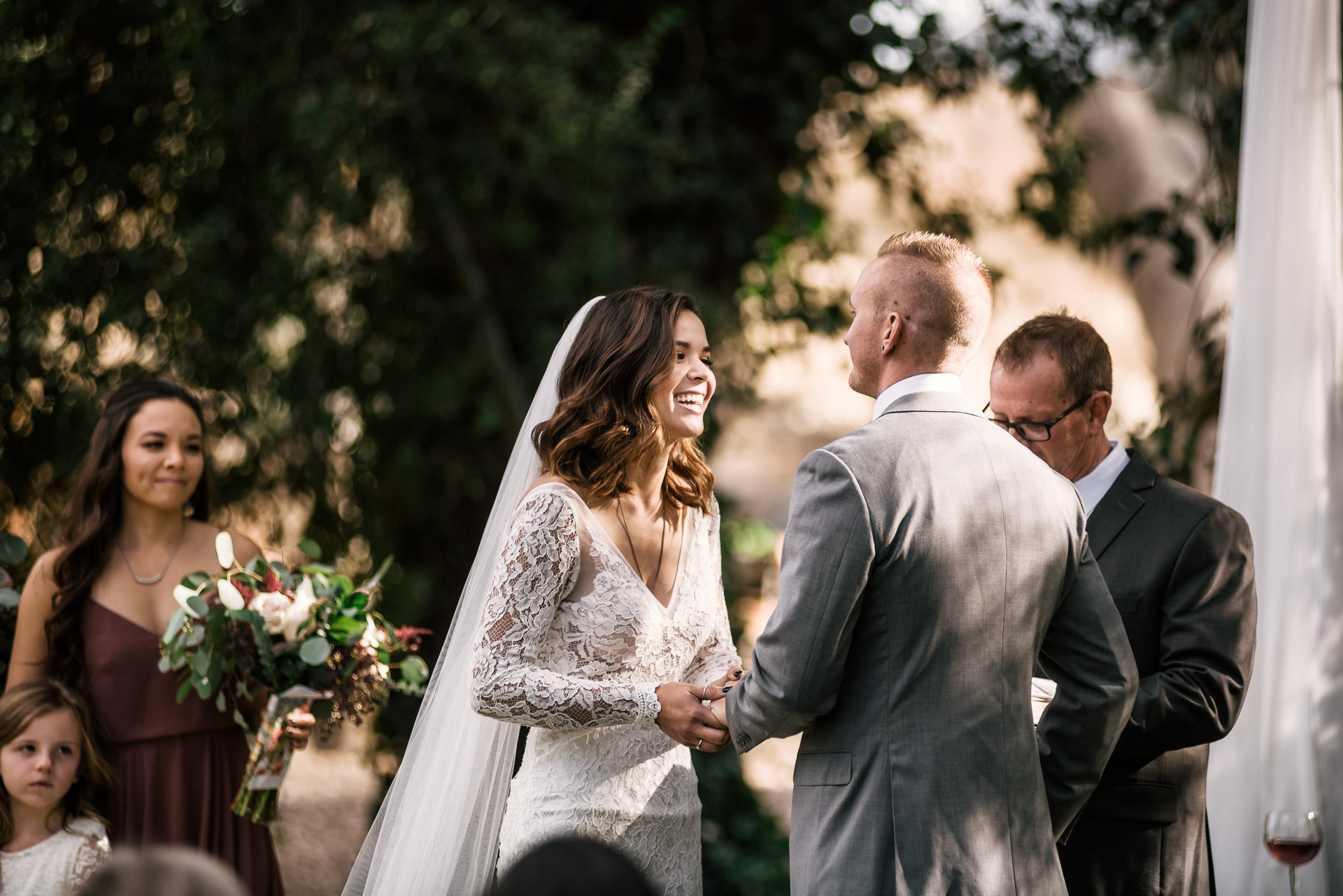 groom makes bride laugh at the rustic Pymm ranch wedding venue in winchester california
