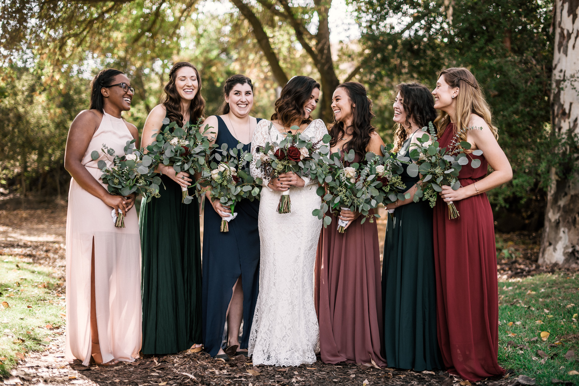 laughing bride and her bridesmaids with eucolyptus bouquet at rustic pymm ranch wedding venue in winchester california