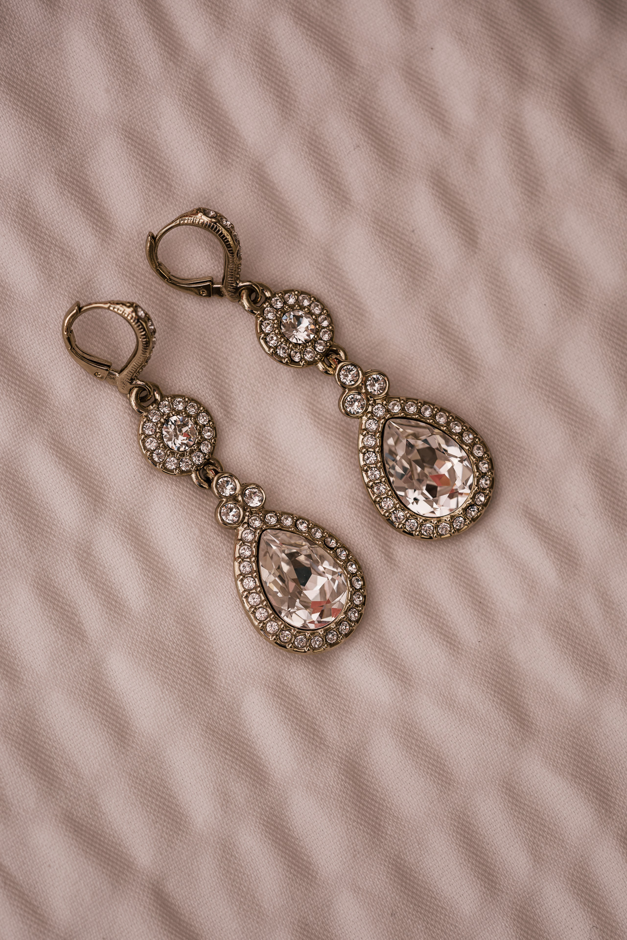 beautiful brides set of earings on a white background at the Twin Oaks Golf course in san marcos, San diegos premier wedding venue