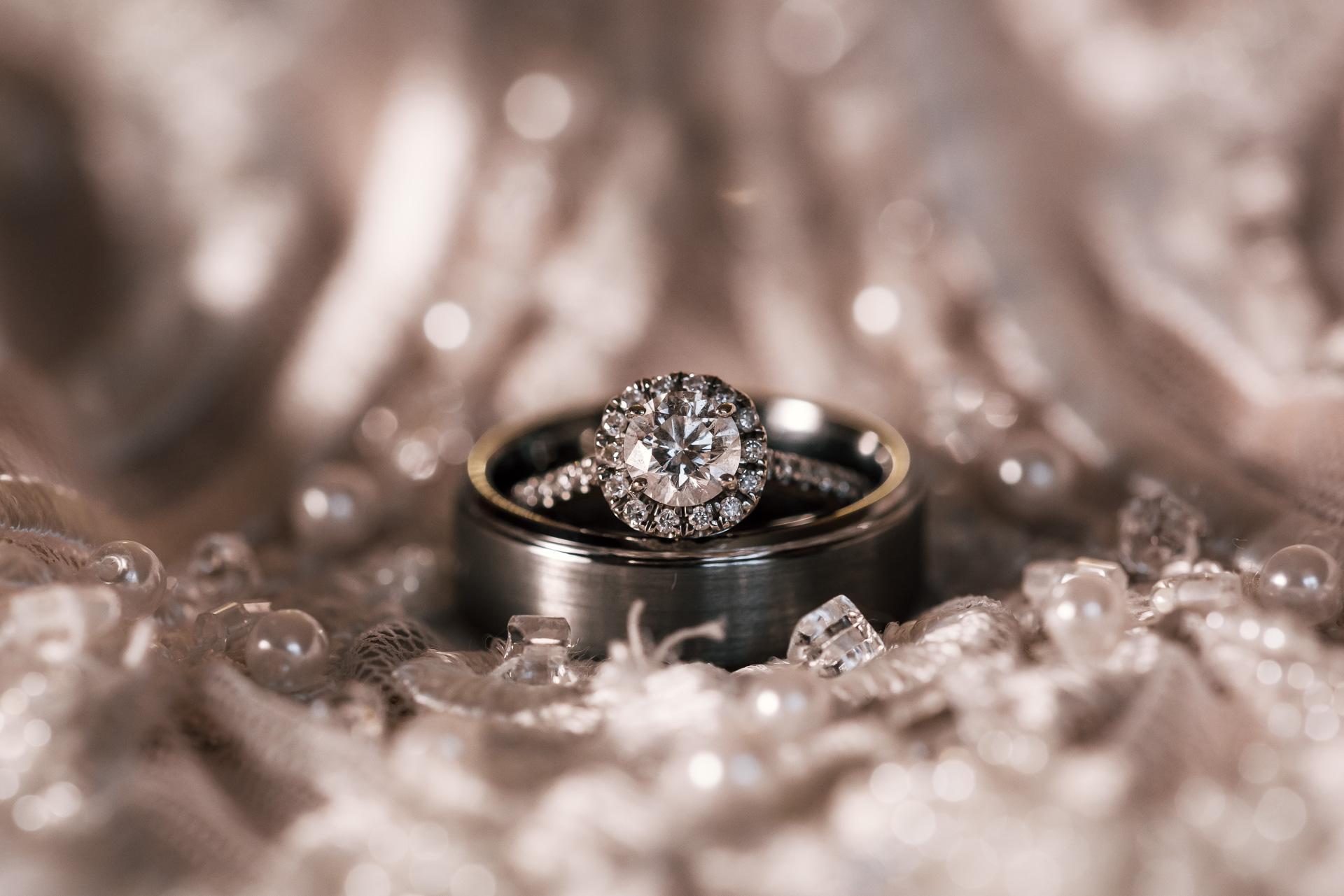 elegant diamond ring on the brides wedding dress at the Twin Oaks Golf course in san marcos, San diegos premier wedding venue