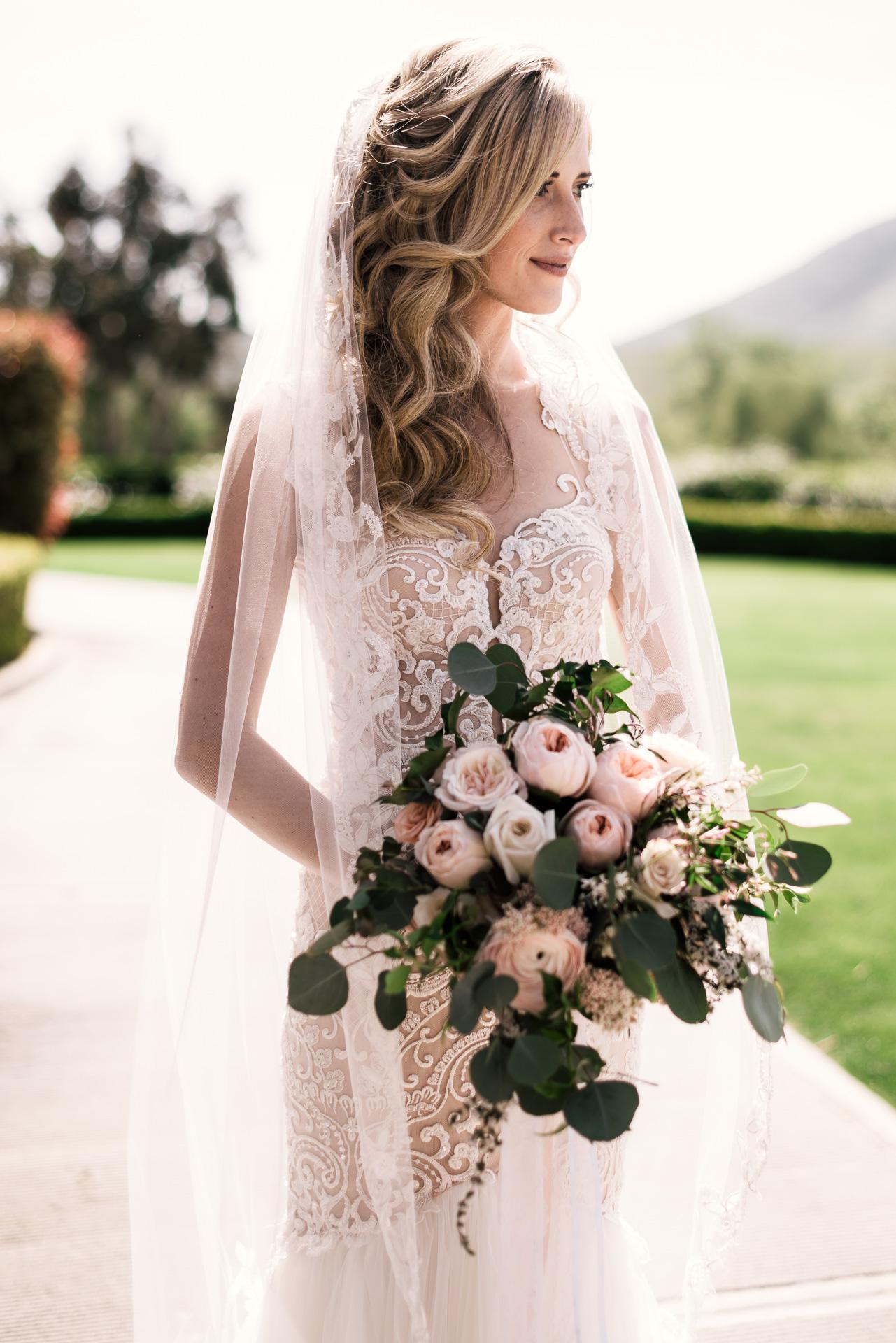 elegant bride portrait with beautiful flower bouquet at the Twin Oaks Golf Course in San Marcos, San Diegos premier wedding venue