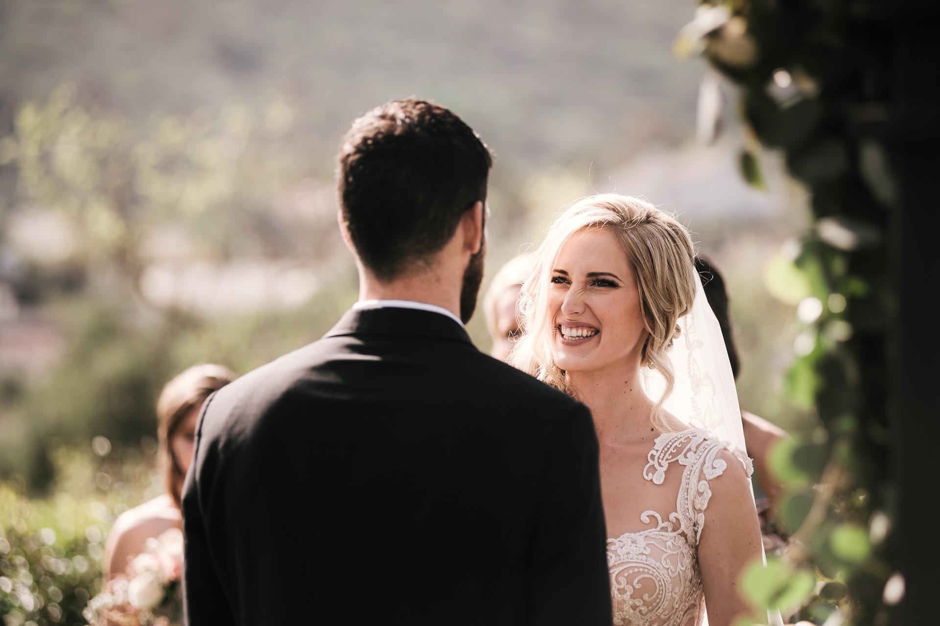 bride laughs at grooms joke at the Twin Oaks Golf Course in San Marcos, San Diegos premier wedding venue