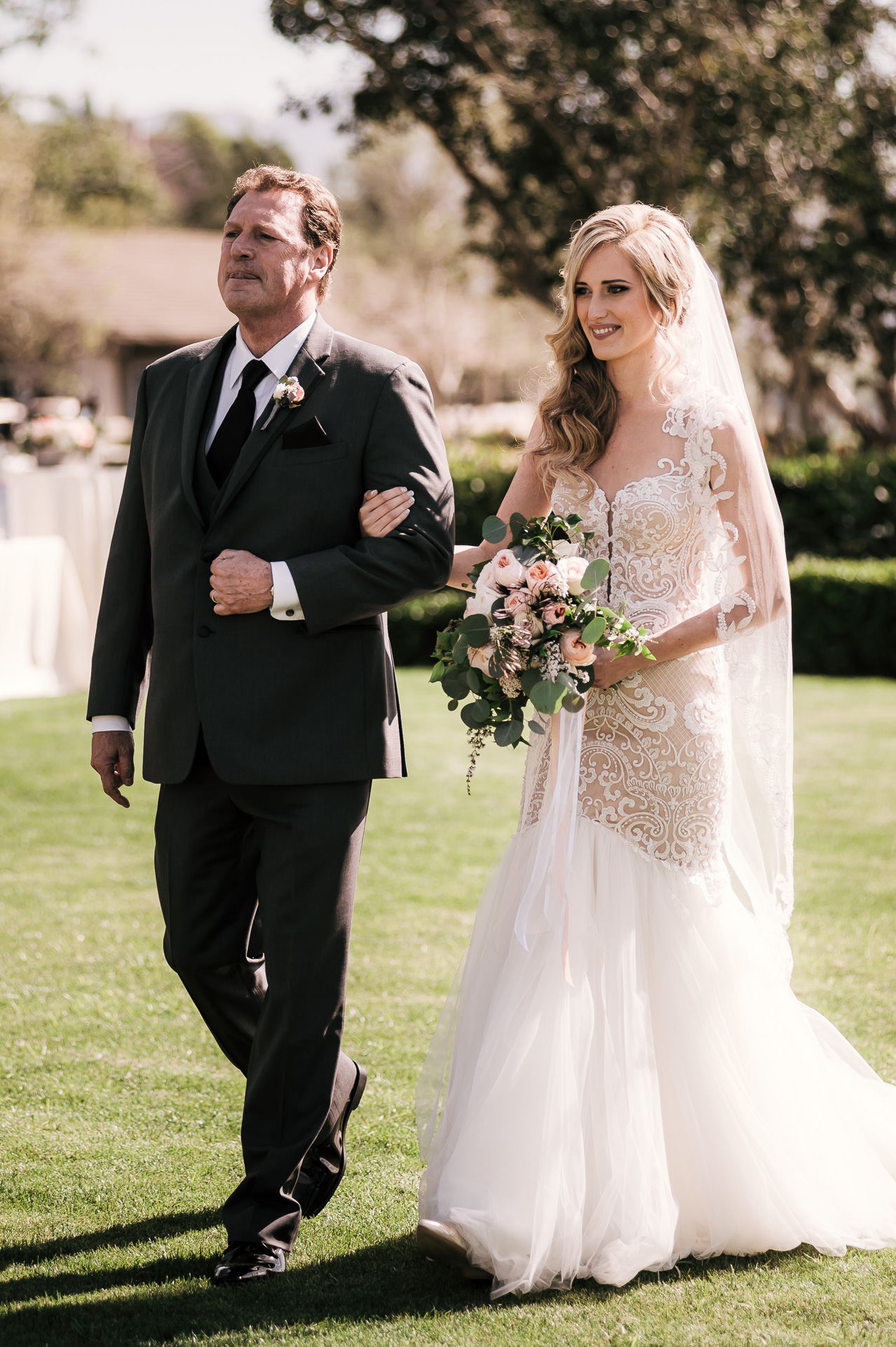 father walks hes daughter down the asile at her wedding at the Twin Oaks Golf Course in San Marcos, San Diegos premier wedding venue