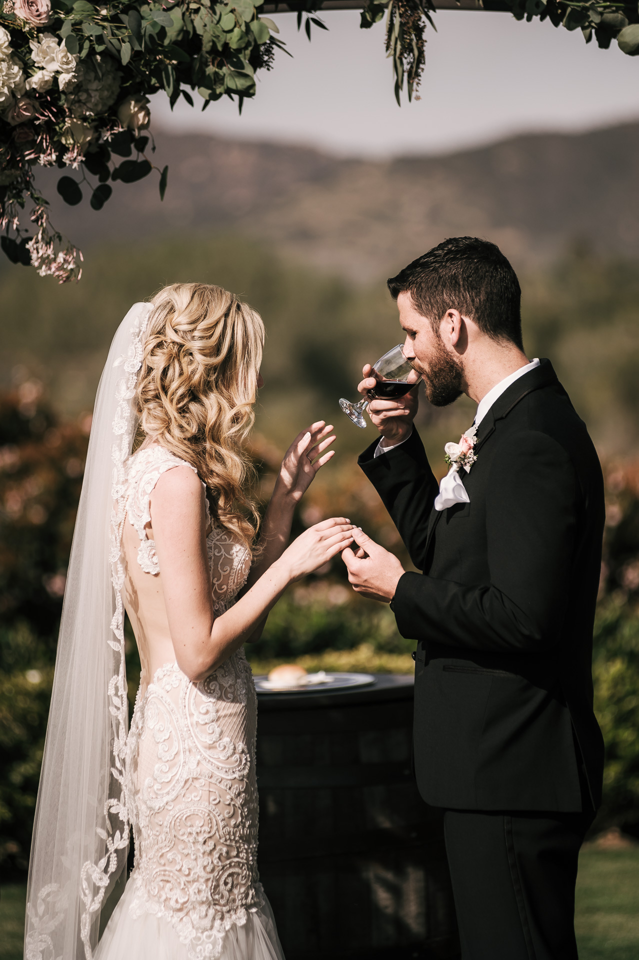 bride and groom do communion after wedding ceremony at the Twin Oaks Golf Course in San Marcos, San Diegos premier wedding venue