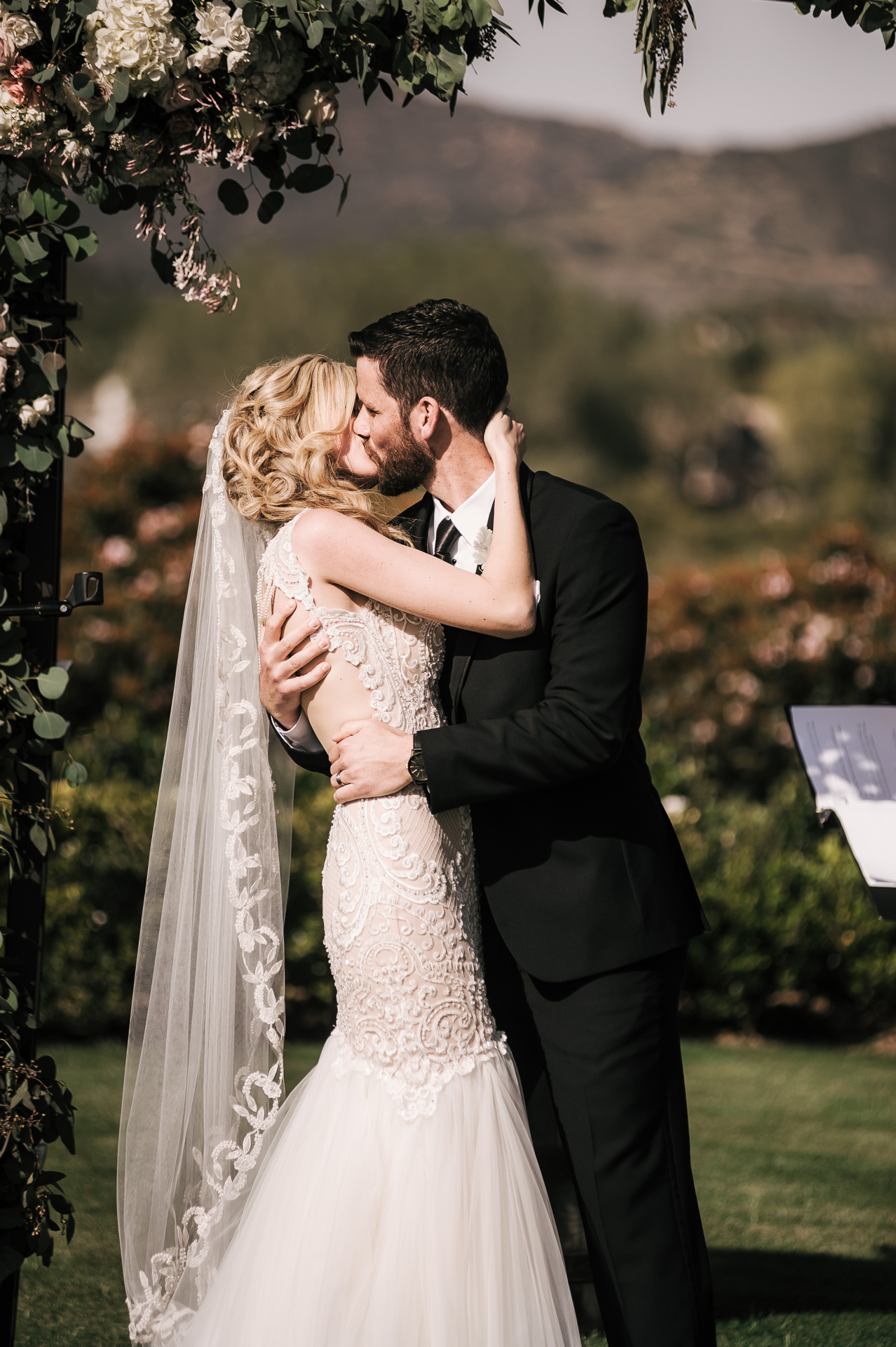 first kiss at the Twin Oaks Golf Course in San Marcos, San Diegos premier wedding venue