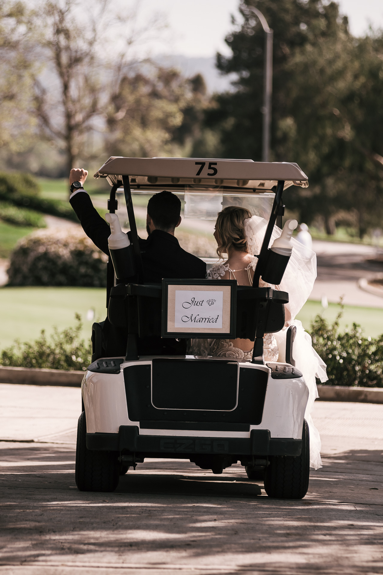 groom drives off with his bride at the Twin Oaks Golf Course in San Marcos, San Diegos premier wedding venue