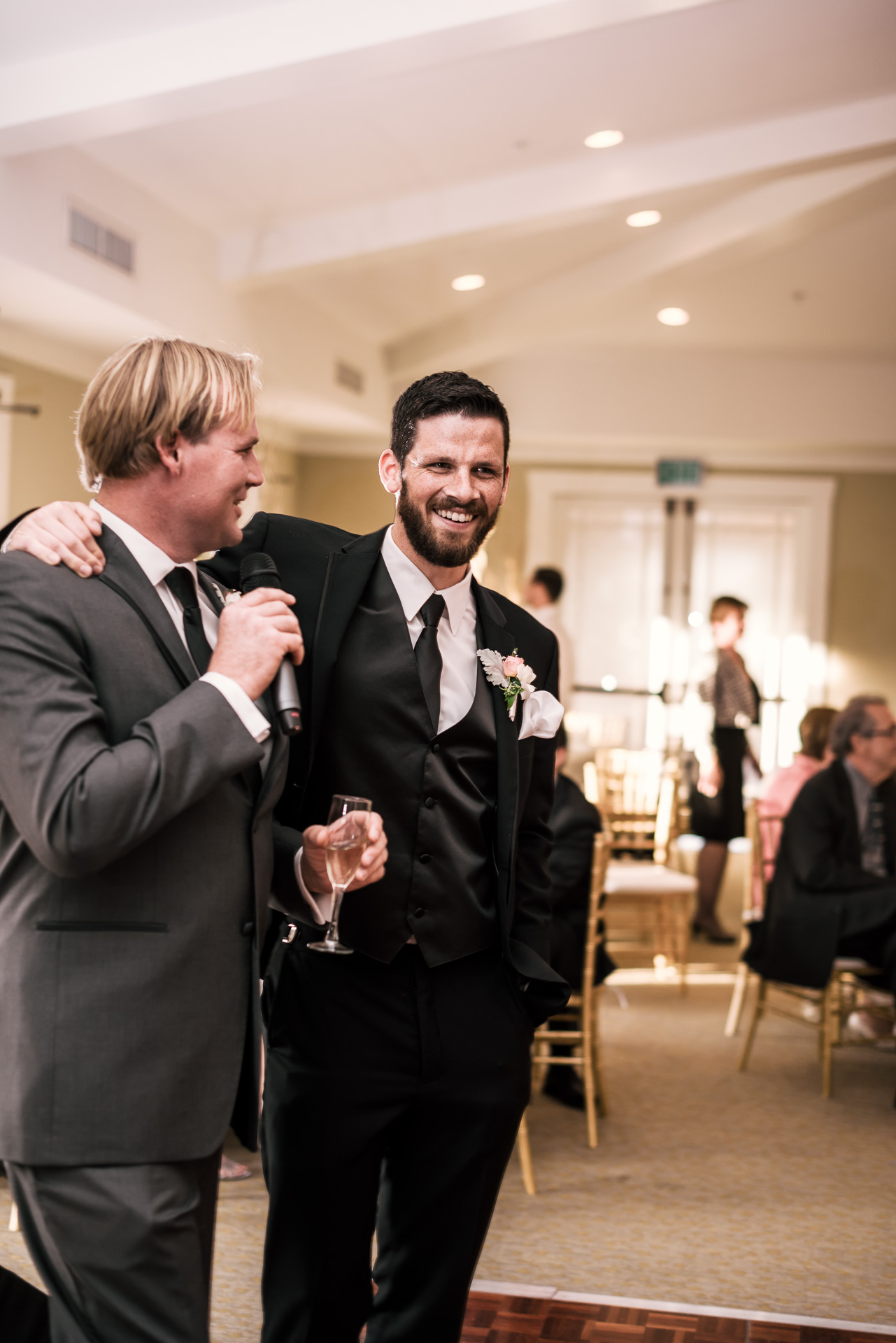 groom puts his arm around bestman as he gives a toast at the Twin Oaks Golf Course in San Marcos, San Diegos premier wedding venue