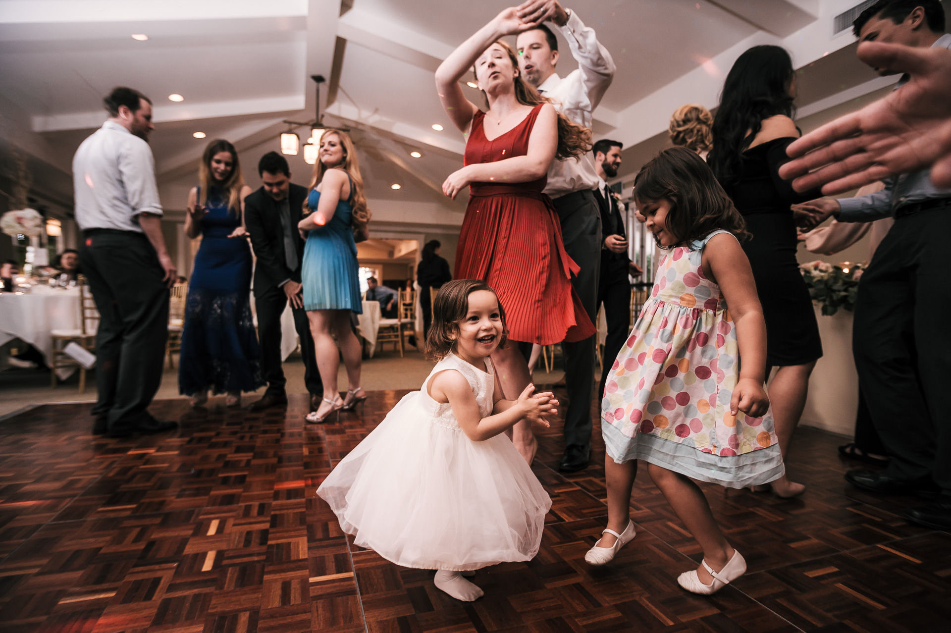 tearing it up on the dance floor during wedding reception at the Twin Oaks Golf Course in San Marcos, San Diegos premier wedding venue